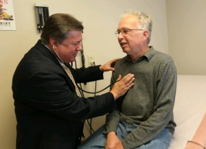 Dr. Richard Vienne. a chief medical officer for Univera Healthcare and a primary care doctor at the Amherst Health Care Center, urges those with back and neck pain try simpler treatments first. (Sharon Cantillon/Buffalo News)