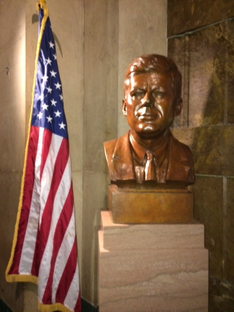 A JFK bust in the City Hall lobby.