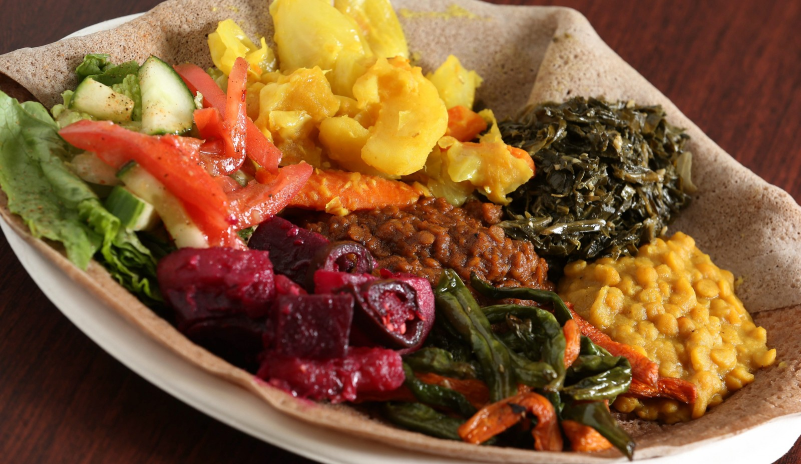 Check out all the food from the West Side Bazaar, like this veggie combo from Abyssinia Ethiopian. (Sharon Cantillon/Buffalo News)