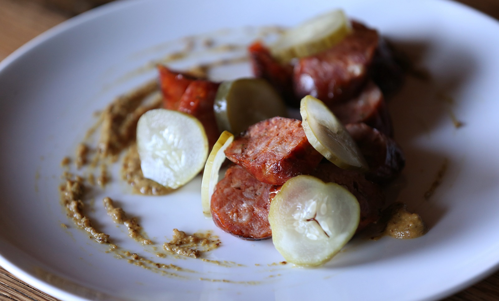 Toutant's smoked sausage appetizer is made with andouille sausage, red eye mustard and pickled cucumbers. (Sharon Cantillon/Buffalo News)