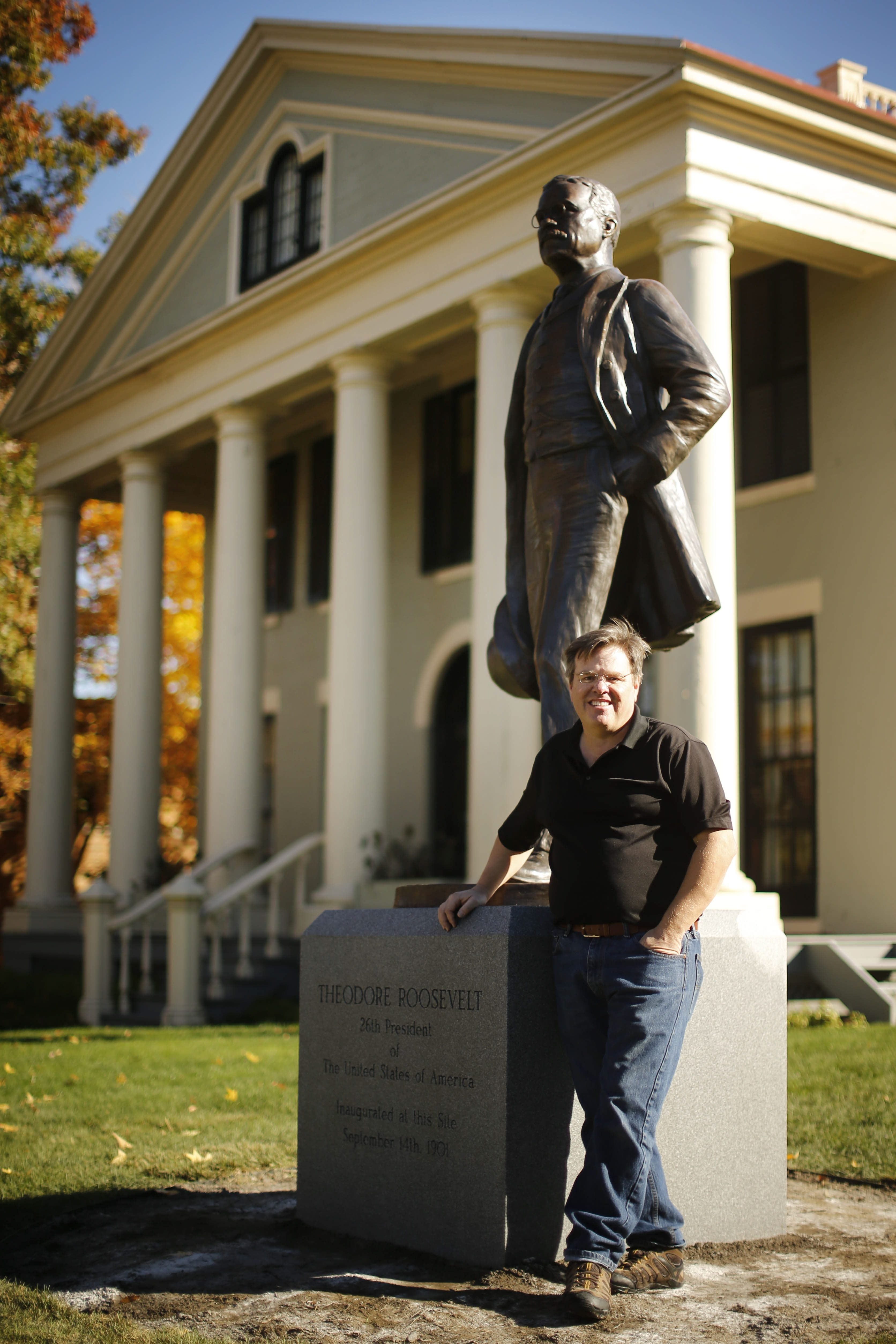 """Artist Antonio Tobias """"Toby"""" Mendez with his statue of President Theodore Roosevelt in front of the Theodore Roosevelt Inaugural Site. (Derek Gee/Buffalo News)"""