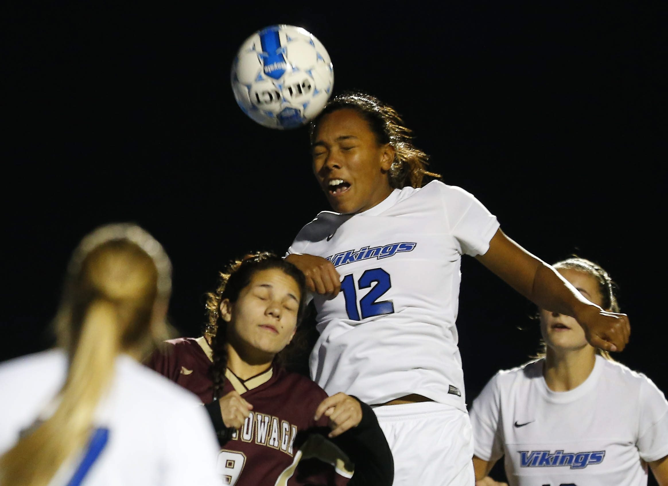 Grand Island's Tiffany Melendez goes for a header over Cheektowaga's Lan Le in their sectional prequarterfinal girls soccer game Tuesday at Grand Island.