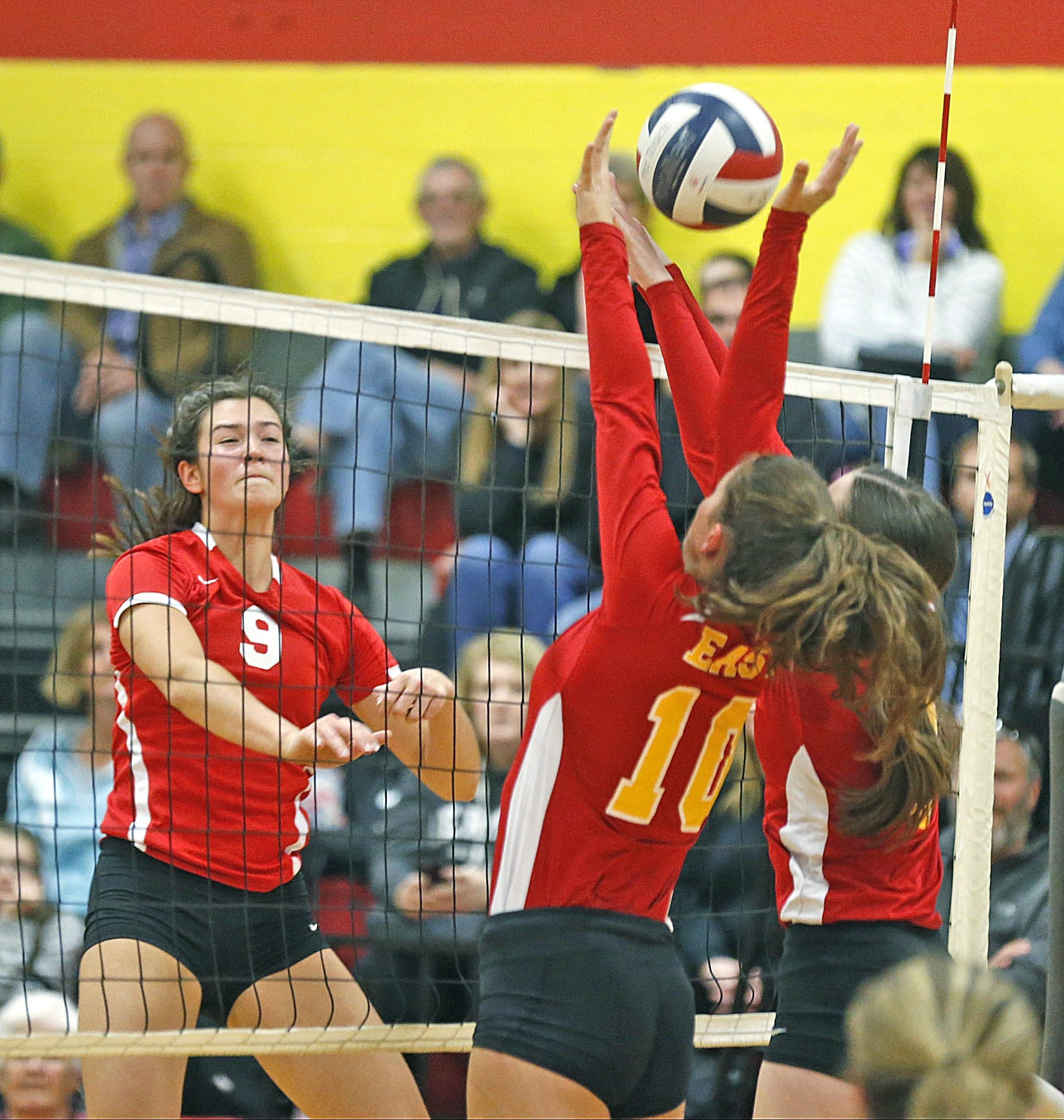 Clarence's Karley King (9) tries to a spike through the block attempt by Williamsville East's Allison Jozwiak (10) in their volleyball match Monday.