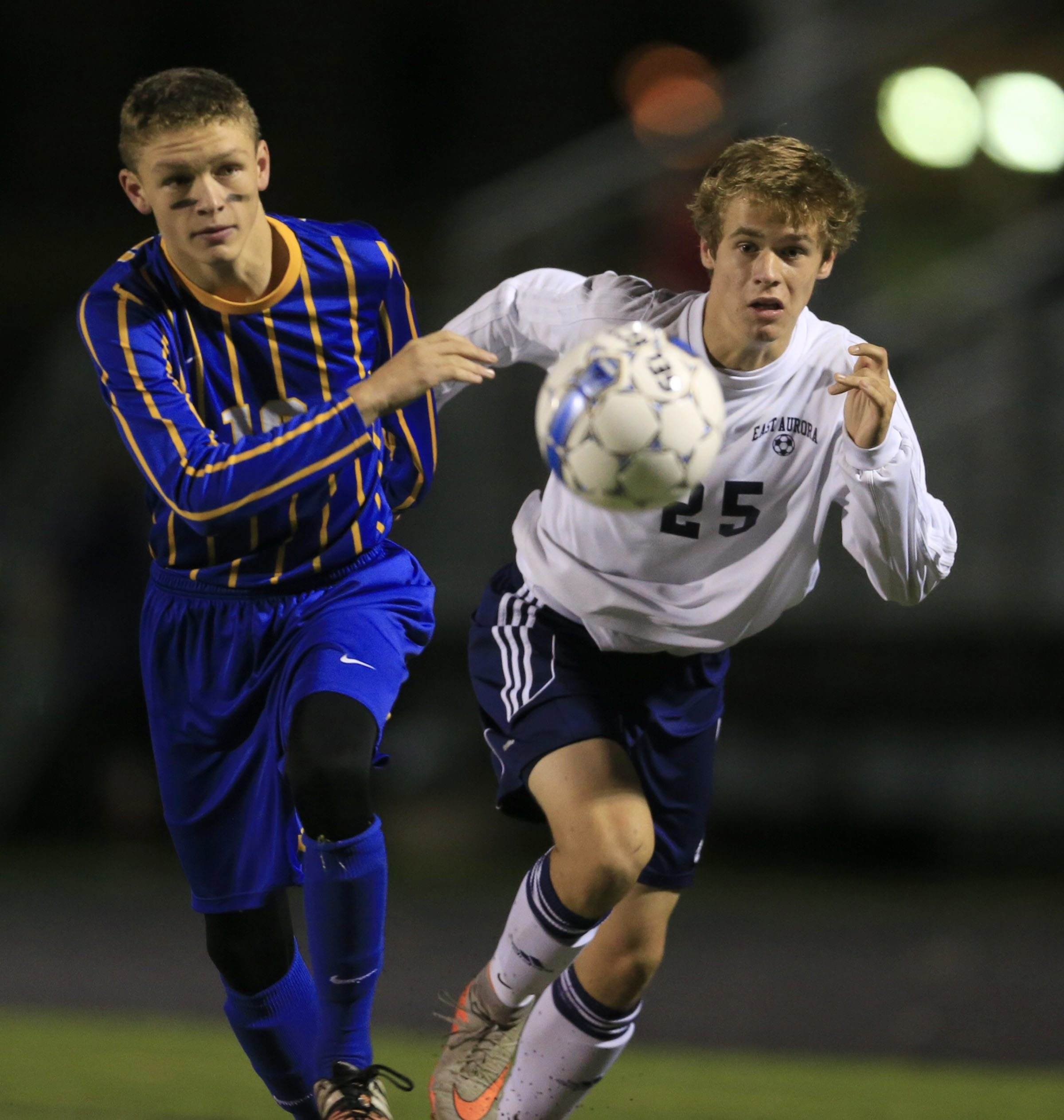 East Aurora's Alex Baase, right, and Alden's Owne Kissell chase a loose ball during the Blue Devils' 5-1 win.
