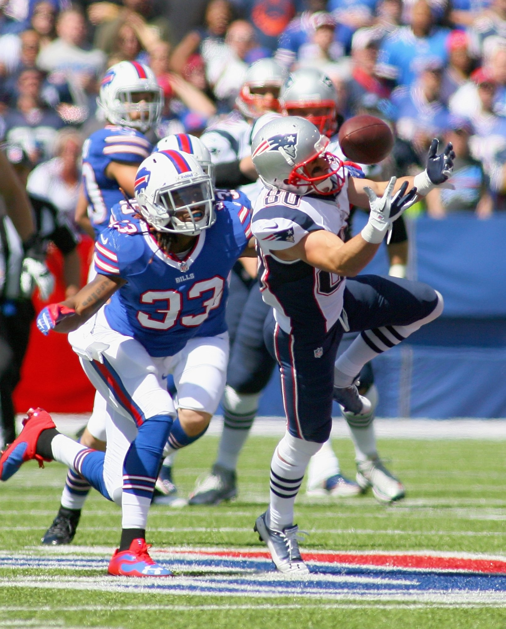 ORCHARD PARK, NY - SEPTEMBER 08:  Danny Amendola #80 of the New England Patriots makes a catch against  Ron Brooks #33 of the Buffalo Bills at Ralph Wilson Stadium on September 8, 2013 in Orchard Park, New York.  (Photo by Rick Stewart/Getty Images)