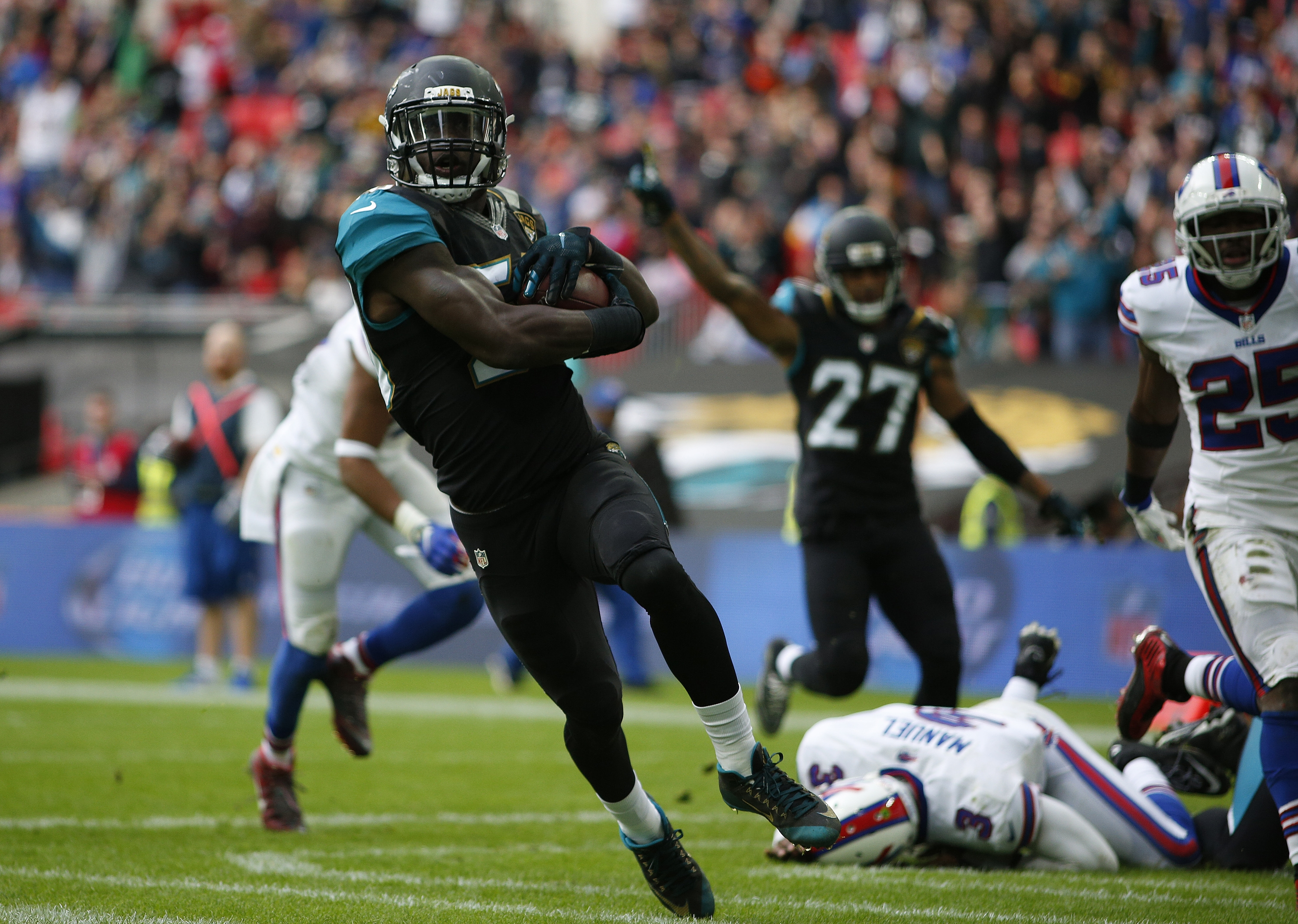 Jaguars linebacker Telvin Smith returns an interception thrown by the Bills' EJ Manuel for a touchdown during the second quarter at Wembley Stadium in London.