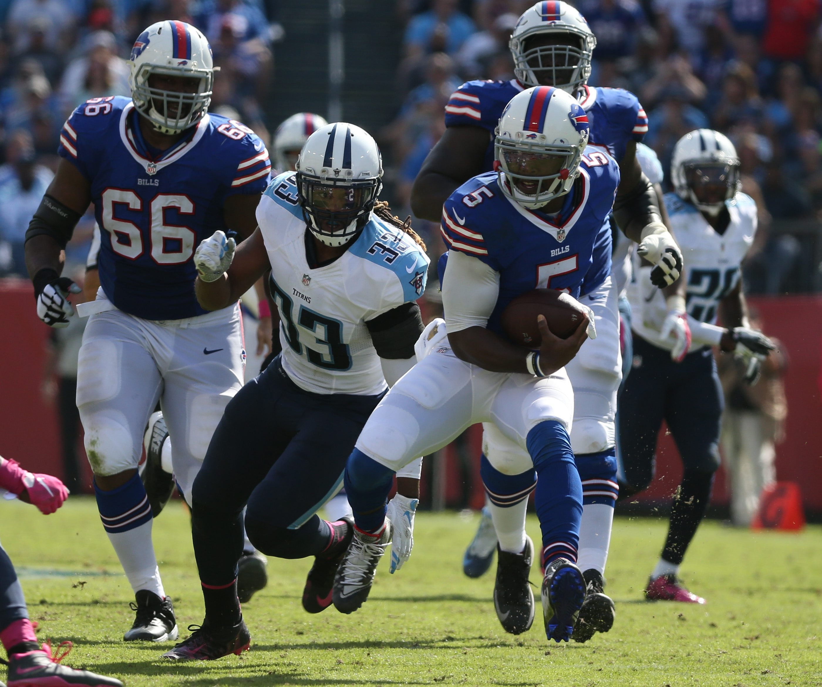Buffalo Bills quarterback Tyrod Taylor (5) rushes for 26 yards and a first down in the third quarter at against the Tennessee Titans in Nashville, Tenn., on Oct. 11, 2015.
