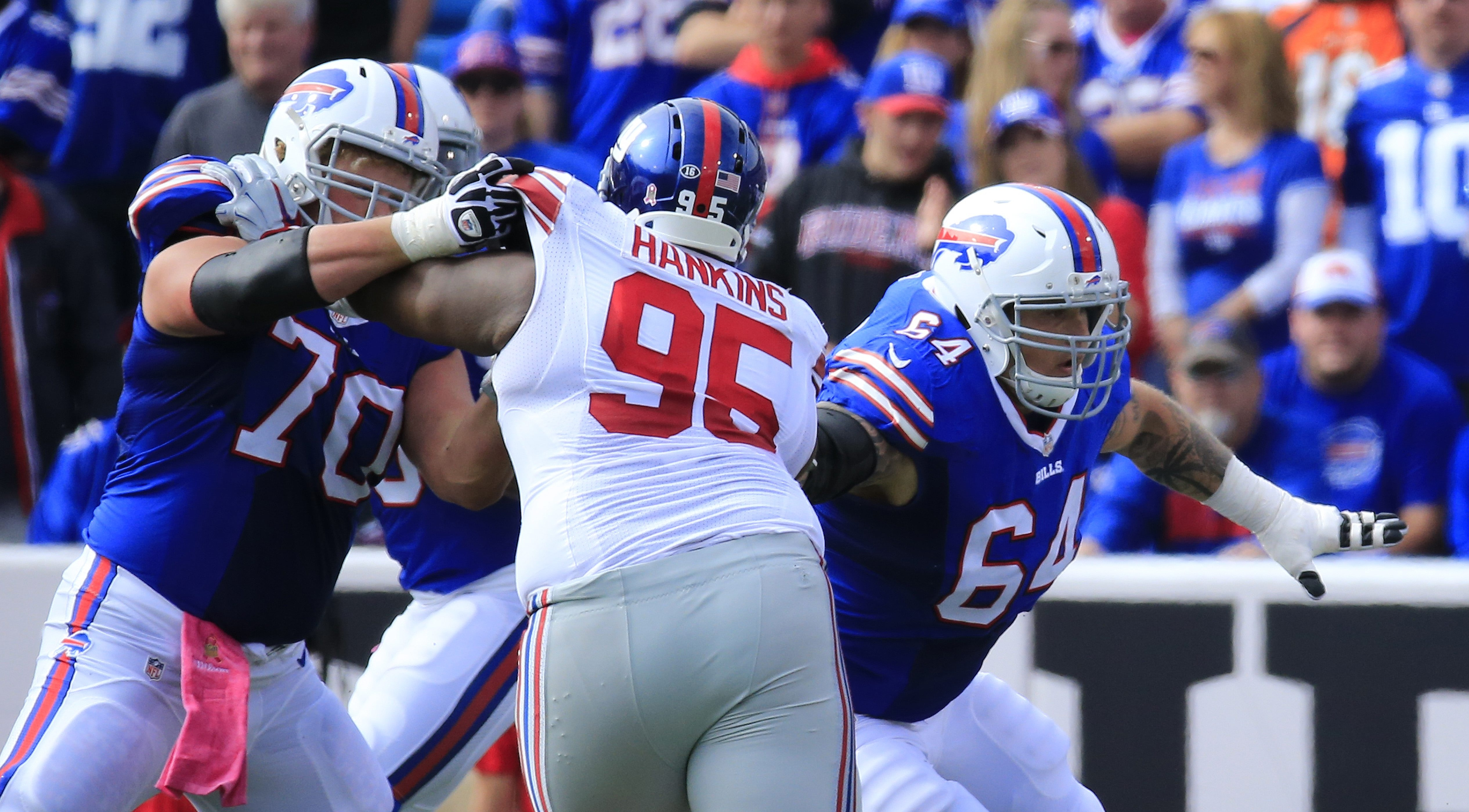 Buffalo Bills offensive linemen Eric Wood (70) and Richie Incognito (64) block Jonathan Hankins of the New York Giants during second-quarter action at Ralph Wilson Stadium on Oct. 4, 2015.