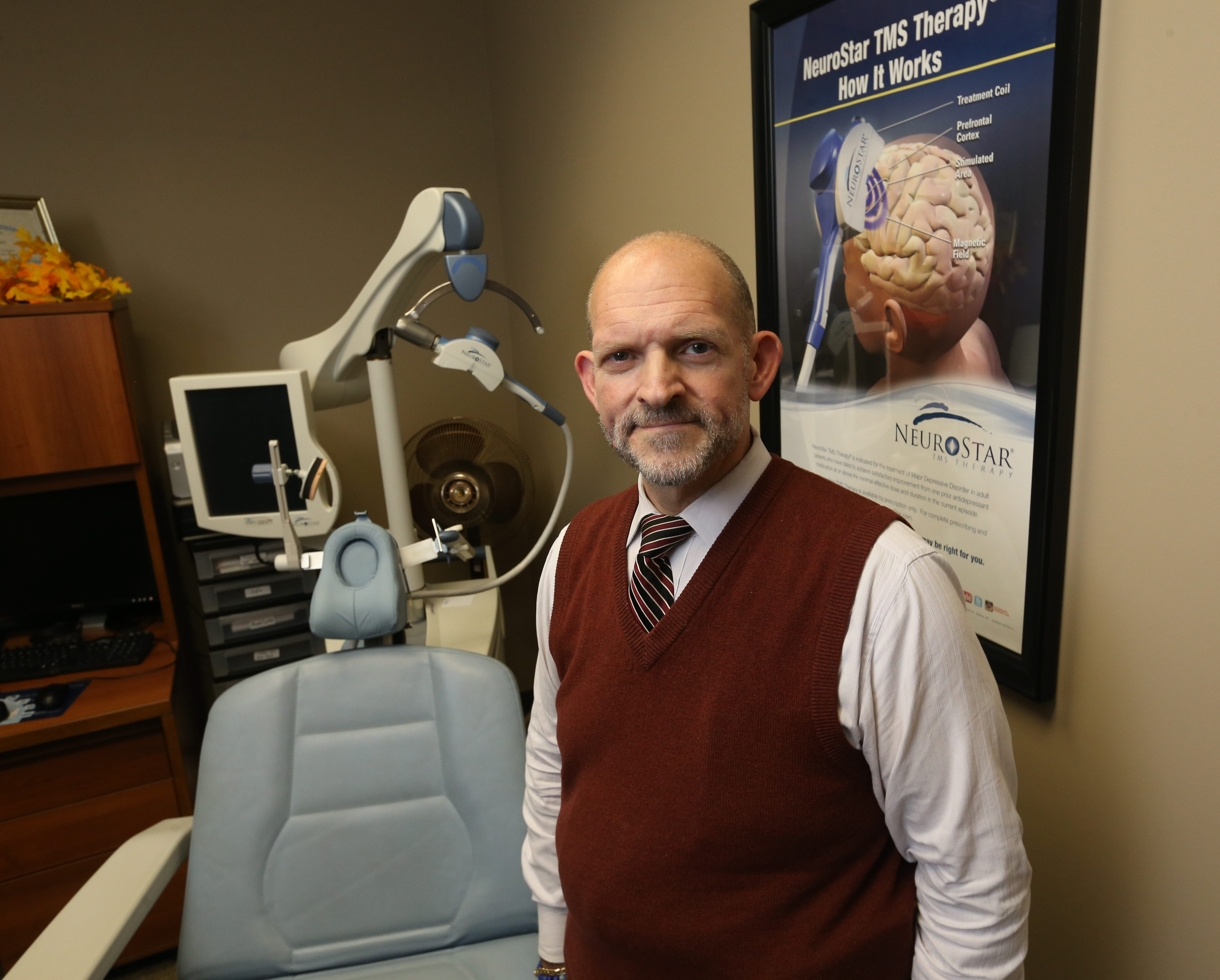 """""""One of the most unique human activities is to think and feel, so to me the brain is the most fascinating area."""" – Dr. Horatio Capote, medical director of the Division of Neuropsychiatry at Dent Neurologic Institute, shown with a Transcranial Magnetic Stimulator (TMS)."""