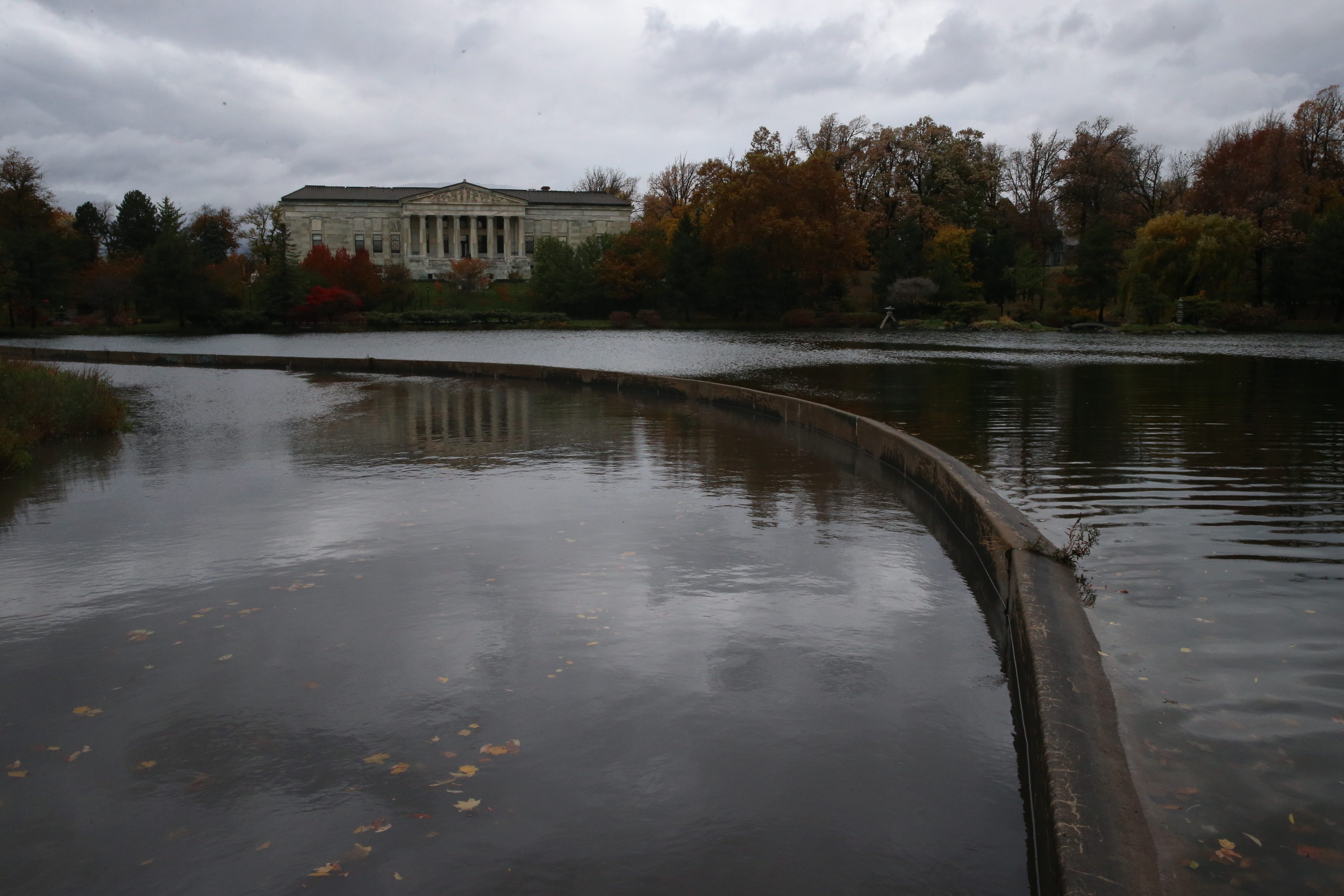 Photo by John Hickey/Buffalo NewsScajaquada Creek flows into Mirror Lake at the Buffalo History Museum, one of the connections where millions of gallons of raw sewagefrom Cheektowaga spoil some of Buffalo's most scenic areas.