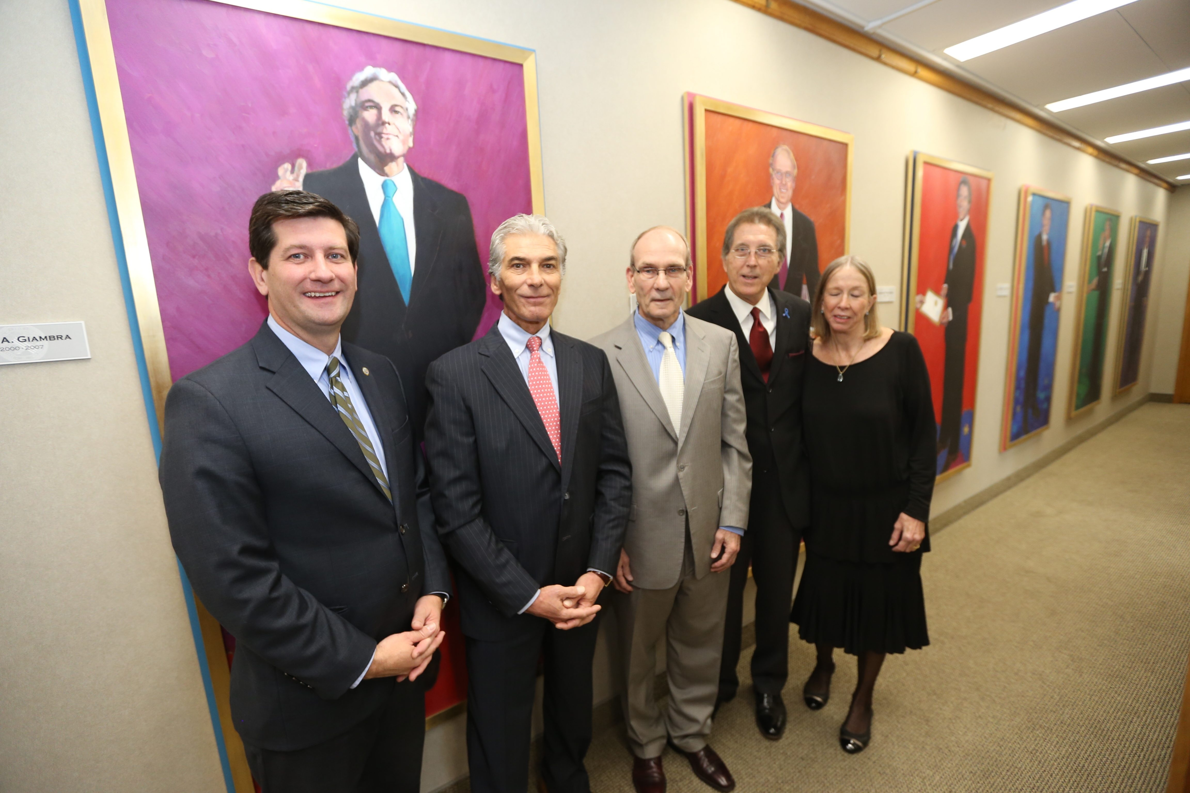 From left, County Executive Mark Poloncarz with predecessors Joel A. Giambra, Dennis Gorski and Ed Rutkowski and artist Mary Smith on Wednesday after the unveiling of six portraits.