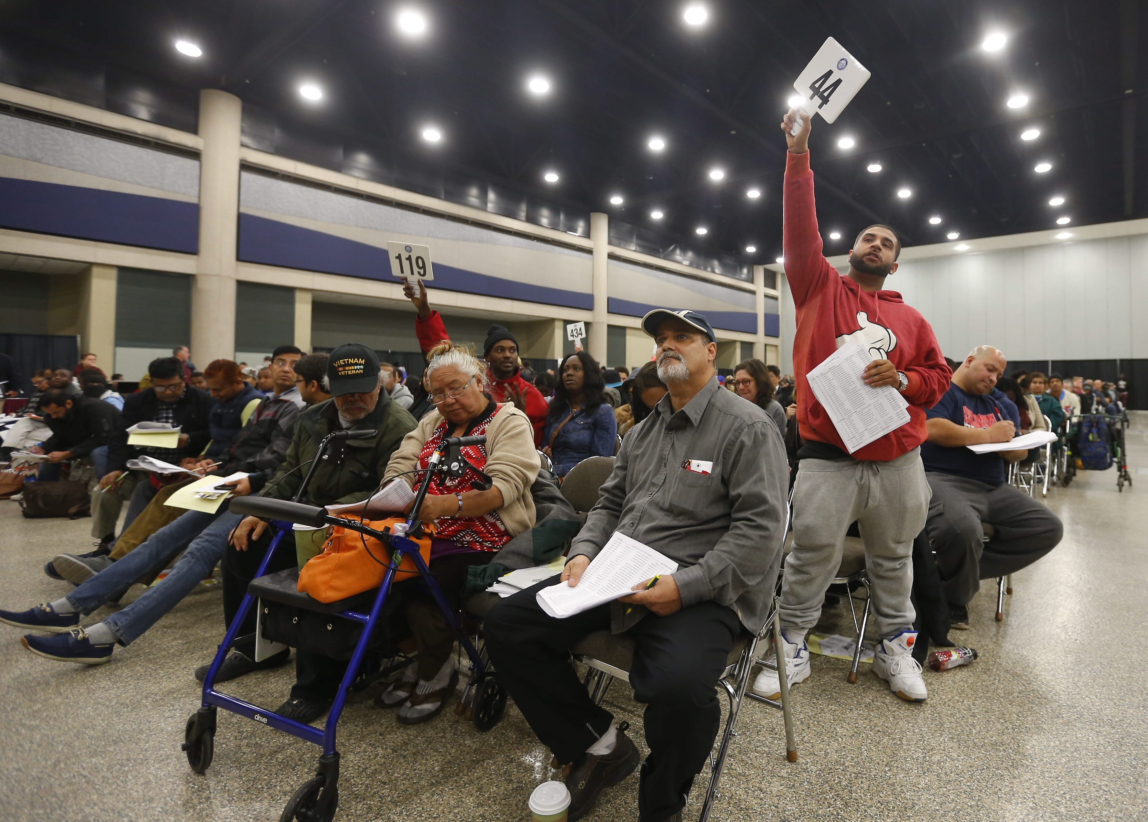 Activity is brisk at city's annual tax foreclosure auction in Buffalo Niagara Convention Center as only a few empty chairs could be seen among 1,200 set up for the event. The event traditionally attracts 400 to 500 people each day. See a photo gallery at buffalonews.com.