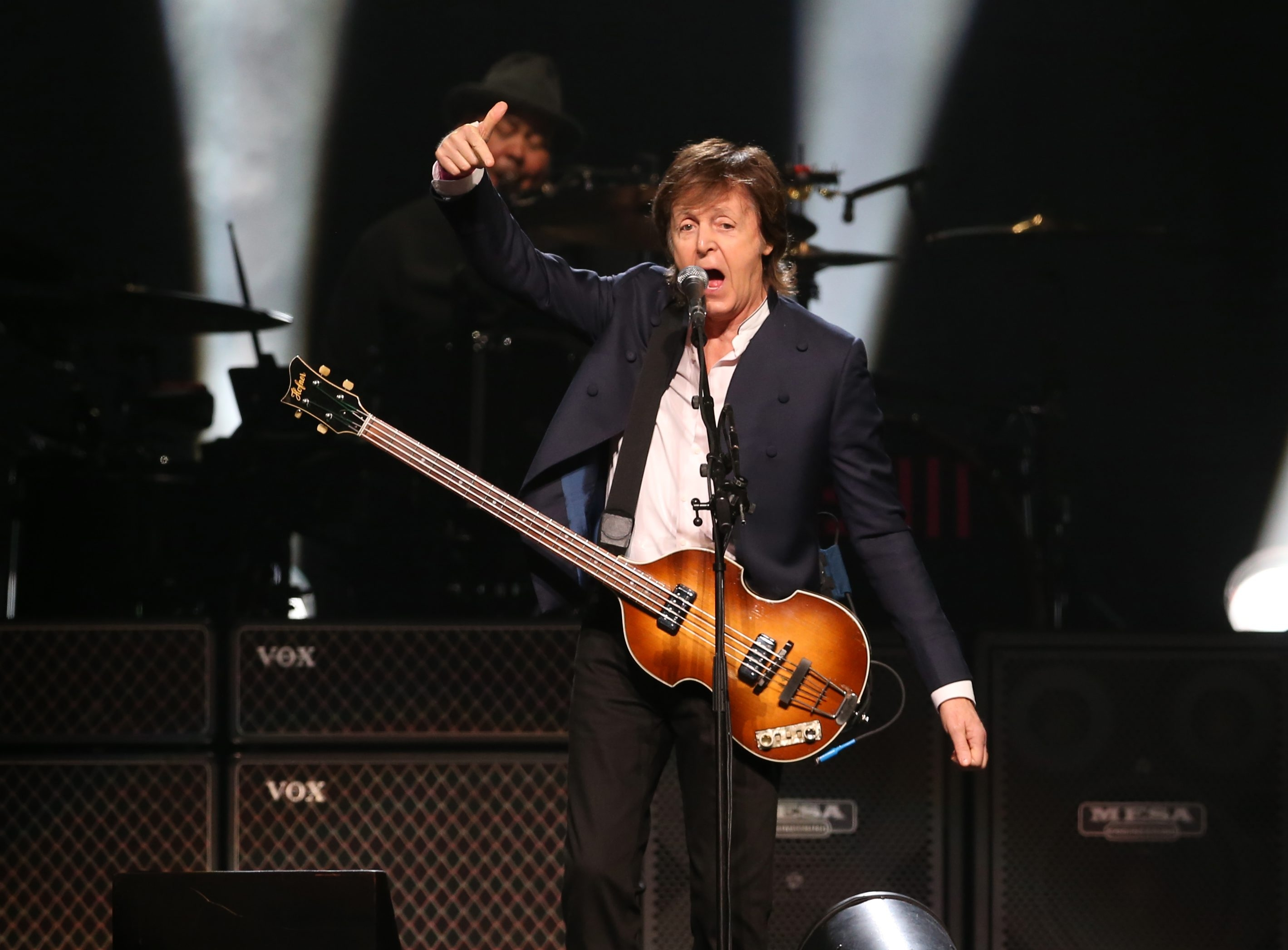 Paul McCartney performs Thursday in First Niagara Center, a sold-out, multimedia show that included a continuous stream of video images playing on a screen behind him.