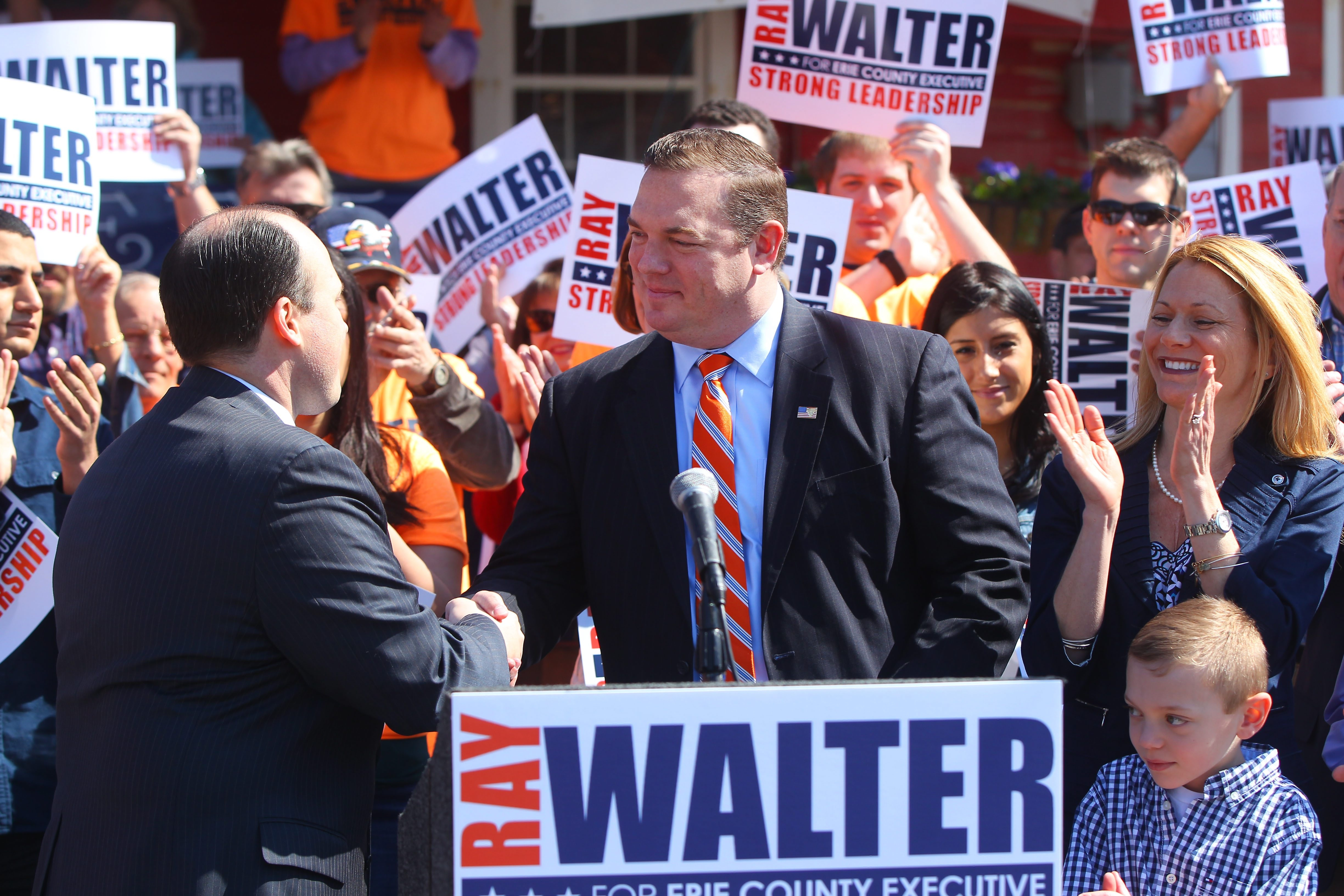 Assembleyman Raymond W. Walter shakes hands with Nicholas A. Langworthy, chairman of the Erie County Republican Party, as Walter announces his candidacy for Erie County Executive in Williamsville on April 18, 2015.