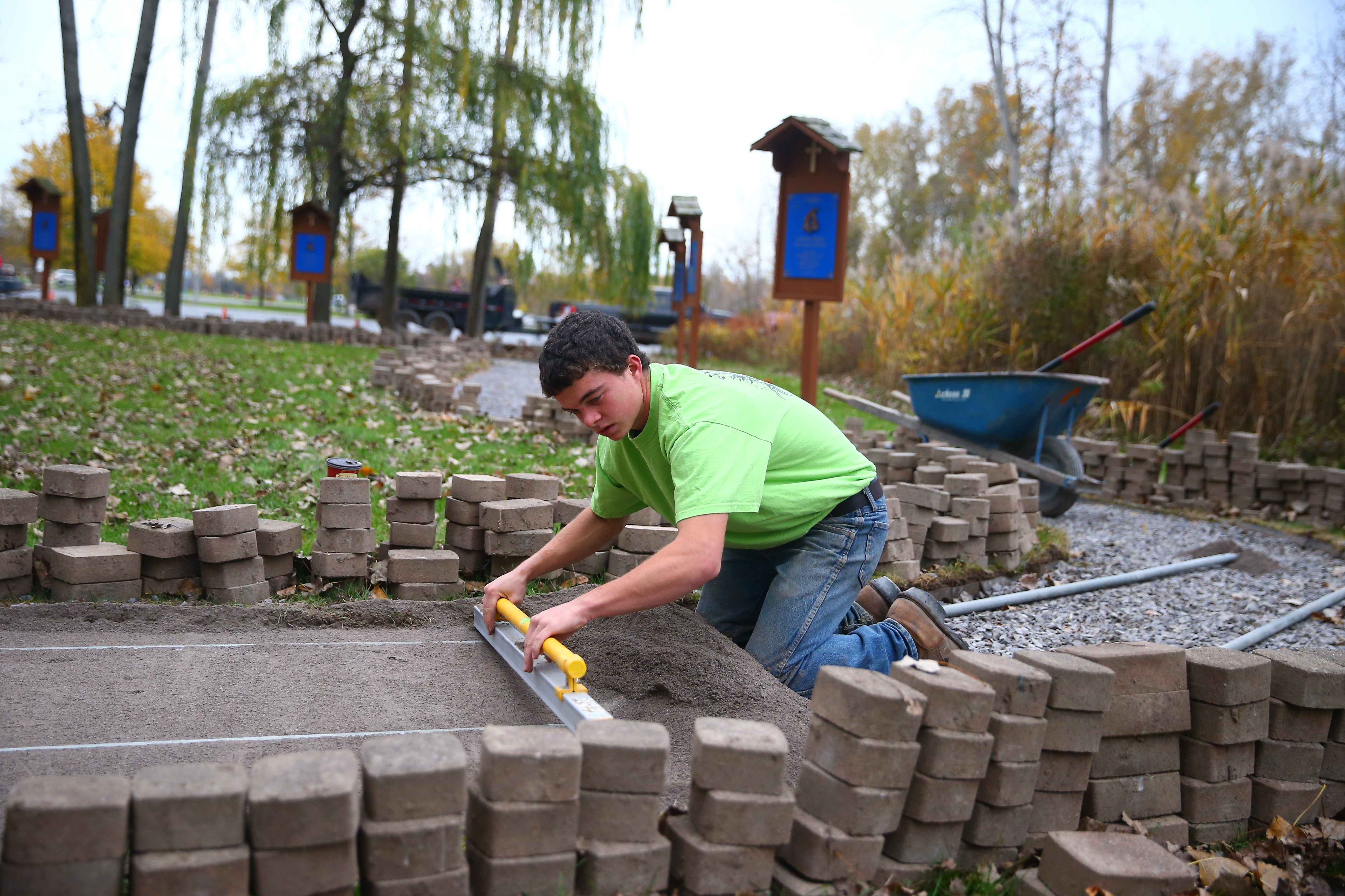 Colton Meyer from Troop 47 in Pendleton assembled a team of 40 to 50 volunteers to help him restore 350 feet of a brick pathway  behind St. Pius X Catholic Church in Getzville for his Eagle Scout project.