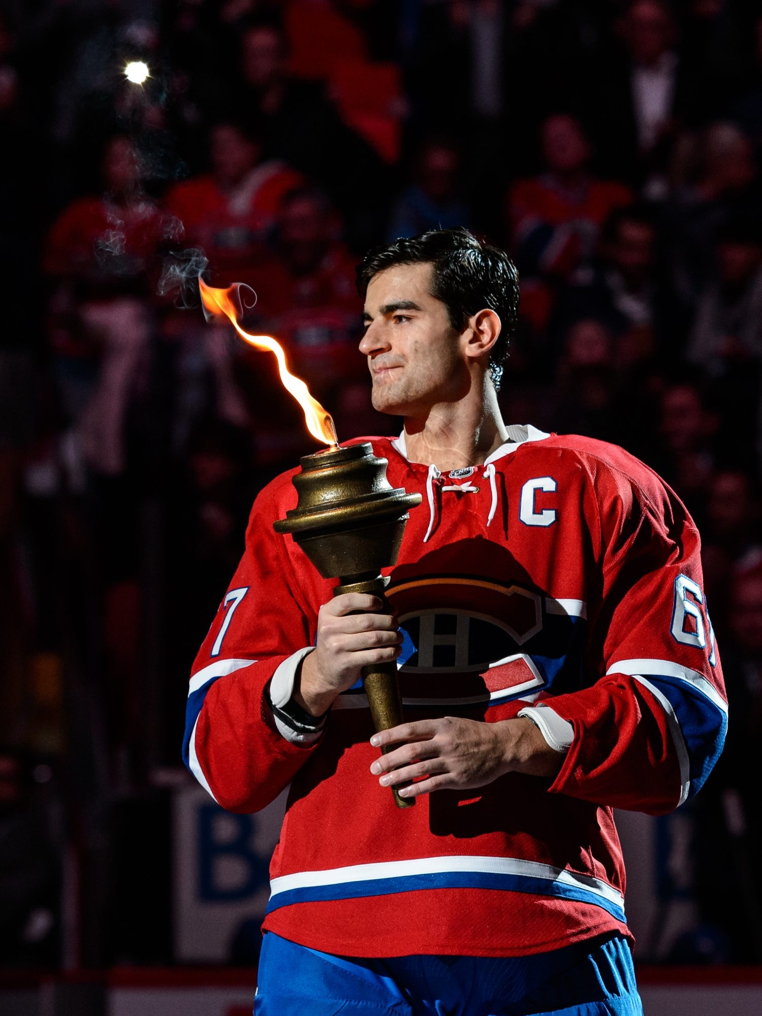 Max Pacioretty accepts the torch symbolic of being named captain of the Montreal Canadiens. He's the third American-born player so honored.