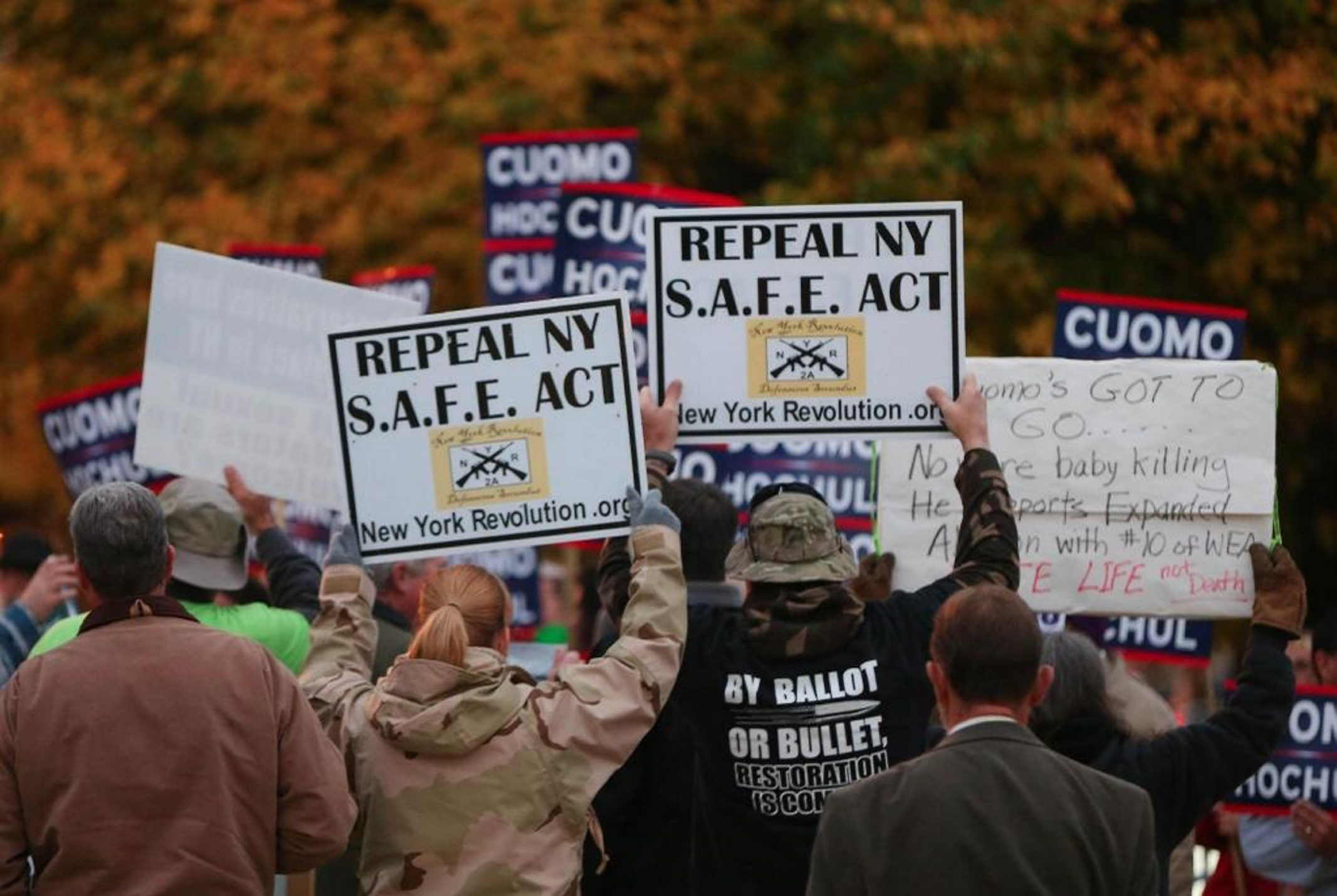 Some opponents of New York's SAFE Act are shown in a file photo outside the 2014 gubernatorial debate in 2014.