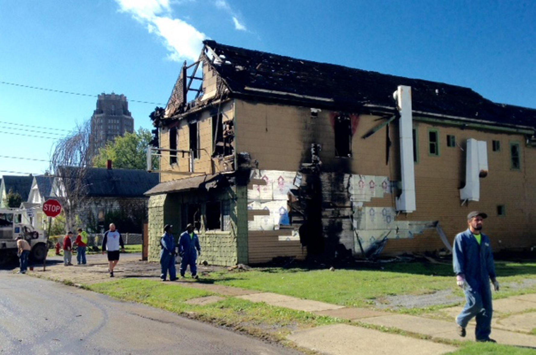 The charred remains were all that remained of this 2½-story rooming house at 392 Curtiss St. after it was engulfed in flames early Saturday morning. Two residents died in the swift-moving blaze.