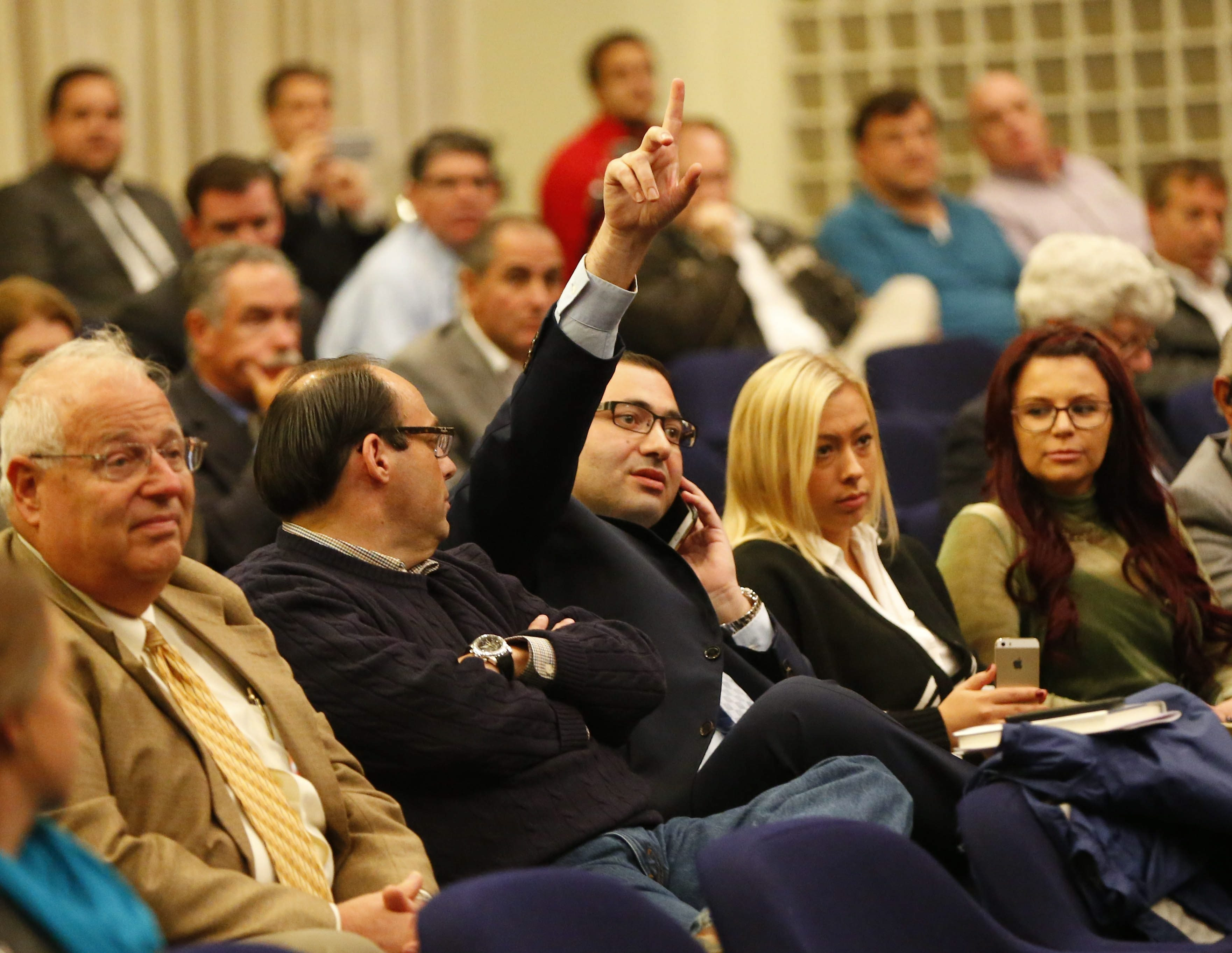 David Nalbandyan places a bid for his group of investors during the auction of One Seneca Tower on Thursday. Despite a huge effort, he failed to obtain the building.