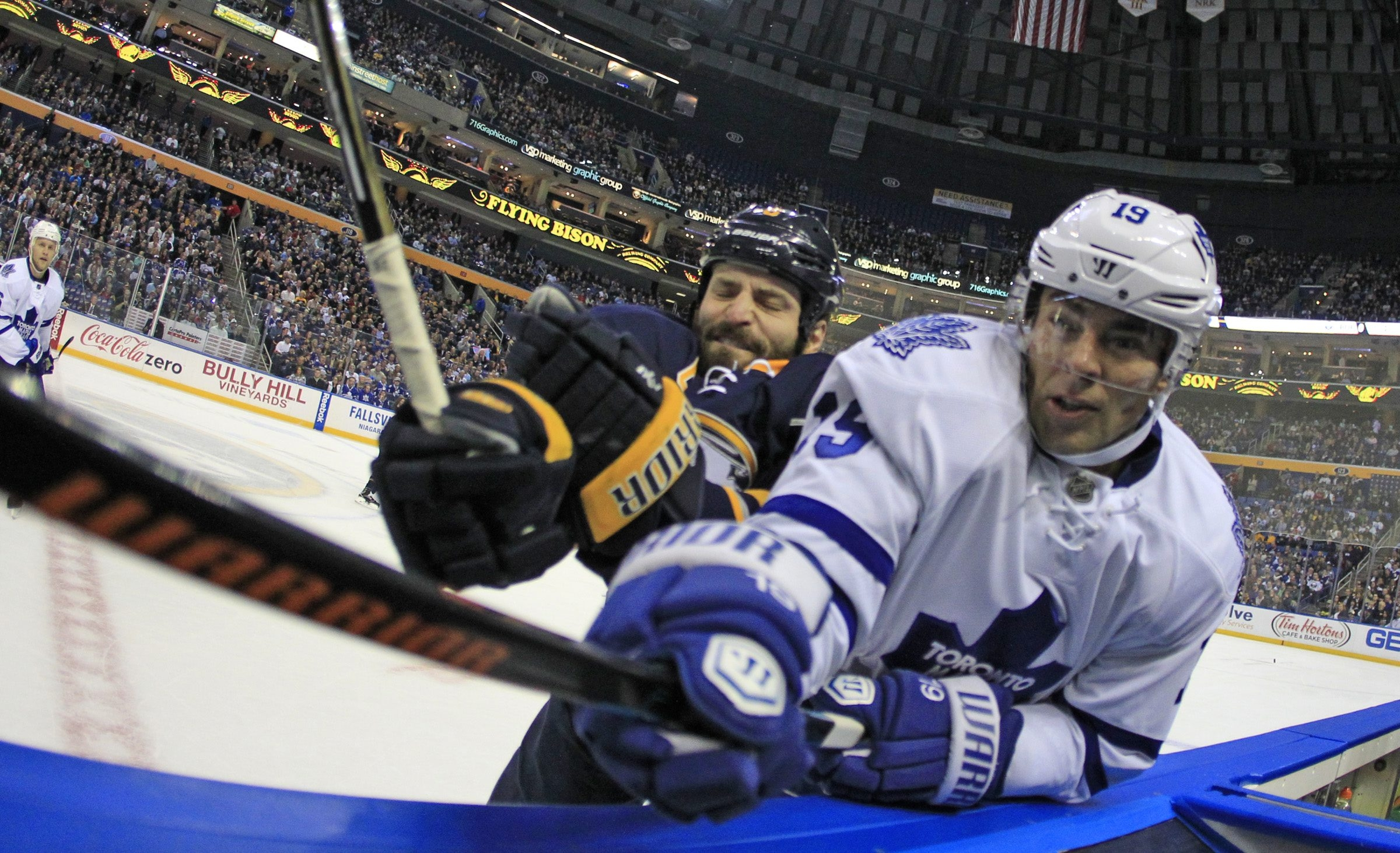 Sabres defenseman Mike Weber checks Joffrey Lupul of the Maple Leafs into the boards during the first period Wednesday.