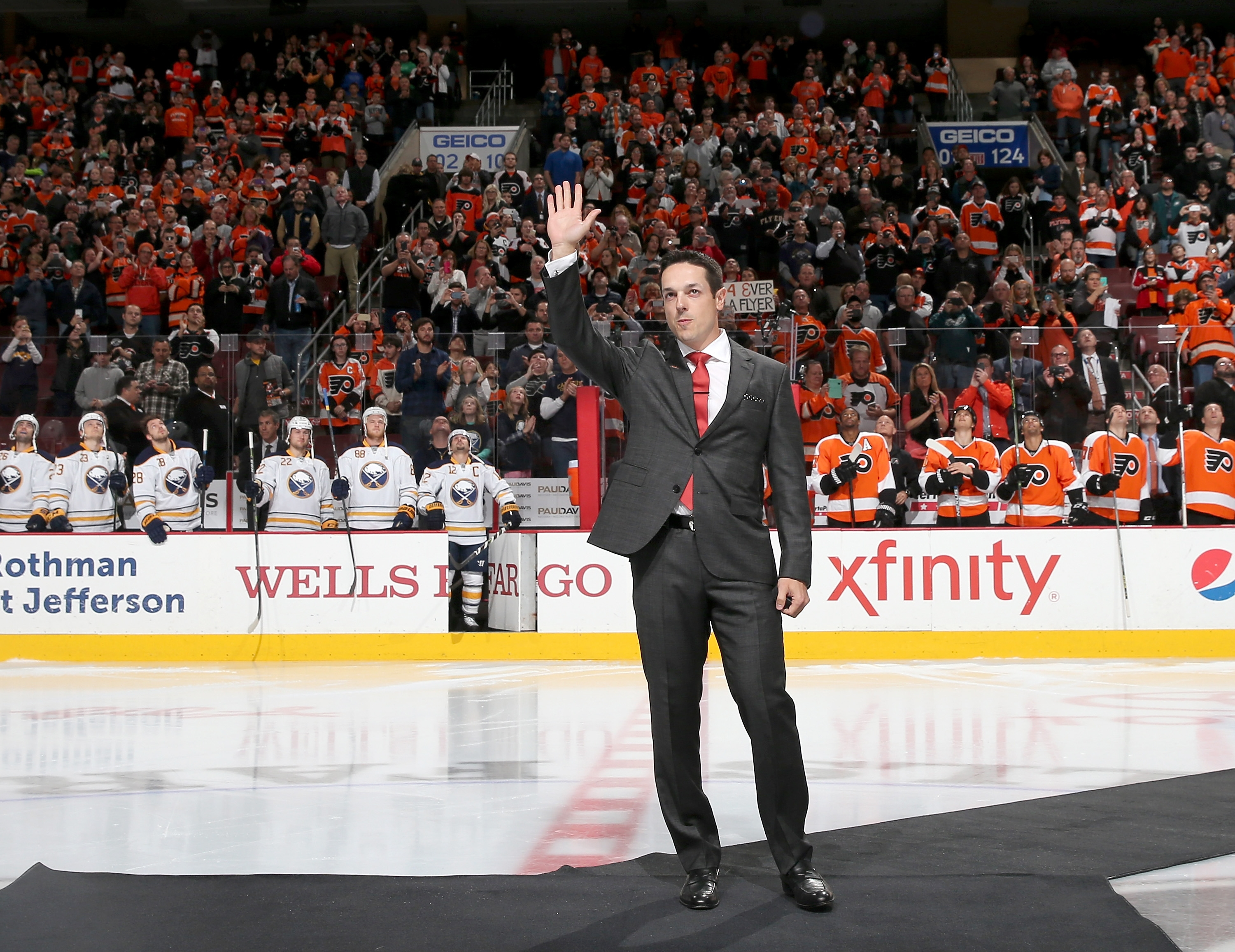 Former Philadelphia Flyer Danny Briere salutes the fans as he is honored before the game against the Buffalo Sabres Tuesday at the Wells Fargo Center in Philadelphia, Pa.
