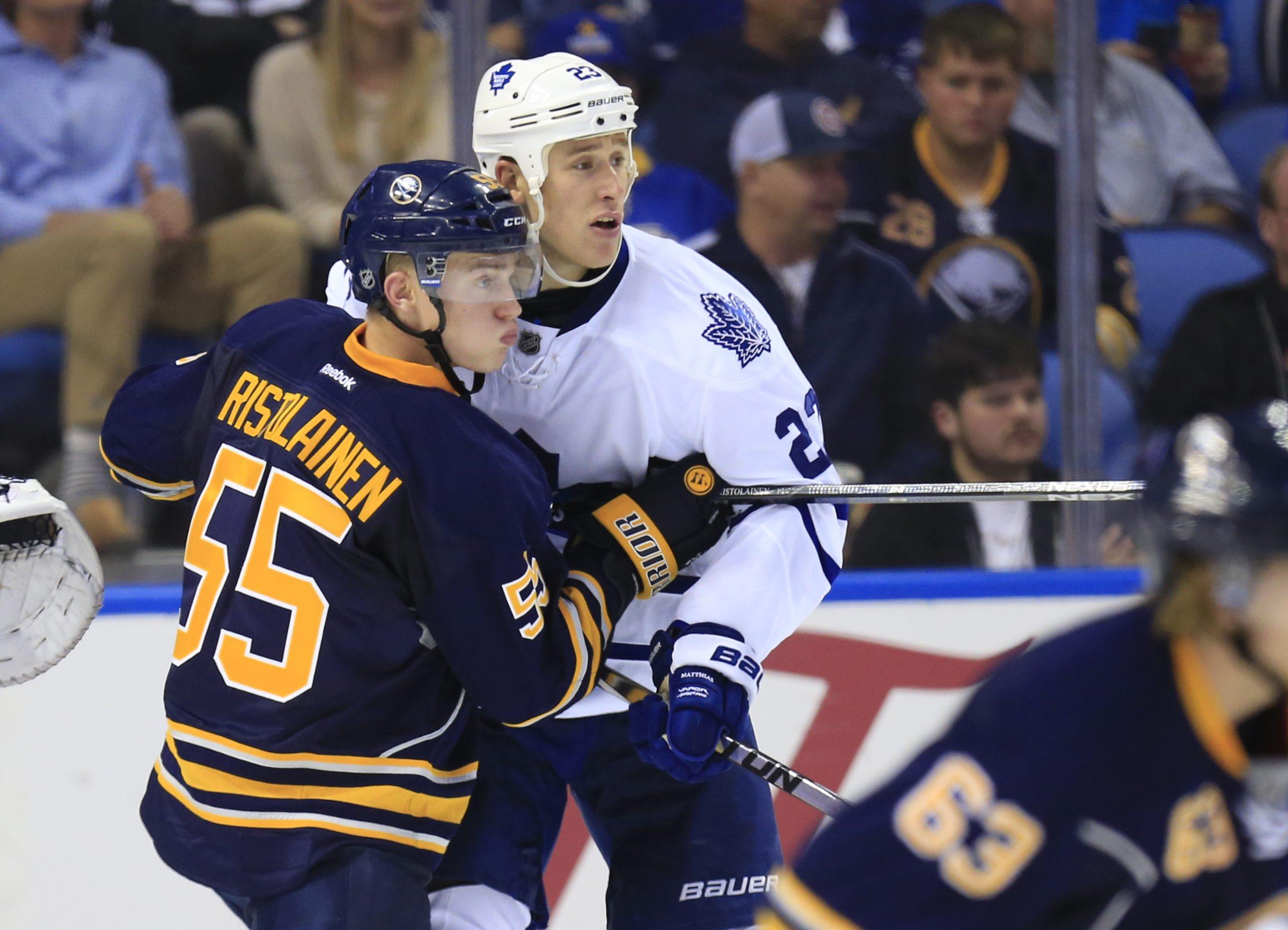 Buffalo's Rasmus Ristolainen checks Toronto's Shawn Matthias last season during one of the previous 99 editions of the rivalry.  (Harry Scull Jr./Buffalo News)