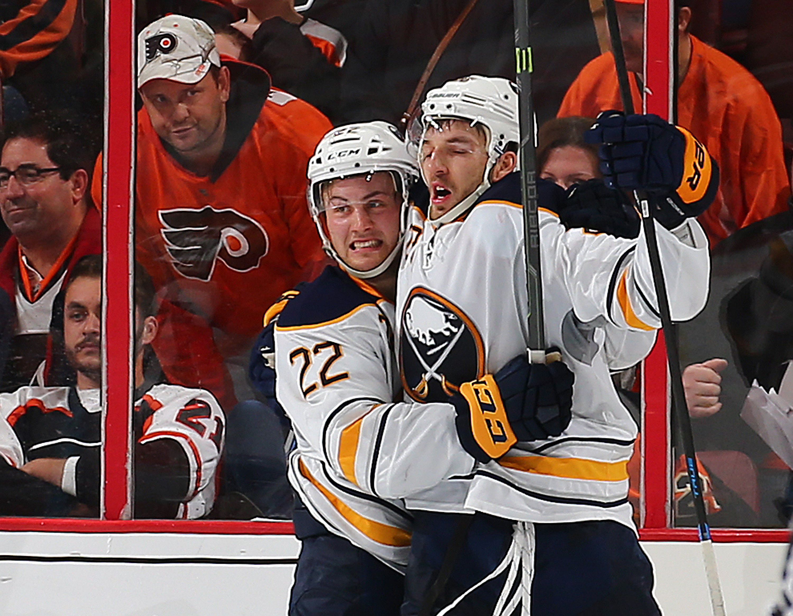 Zemgus Girgensons celebrates his game-winning overtime goal with Johan Larsson (22). (Getty Images)