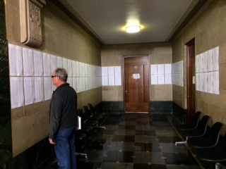 List of properties threatened with foreclosure by the City posted on first floor of City Hall