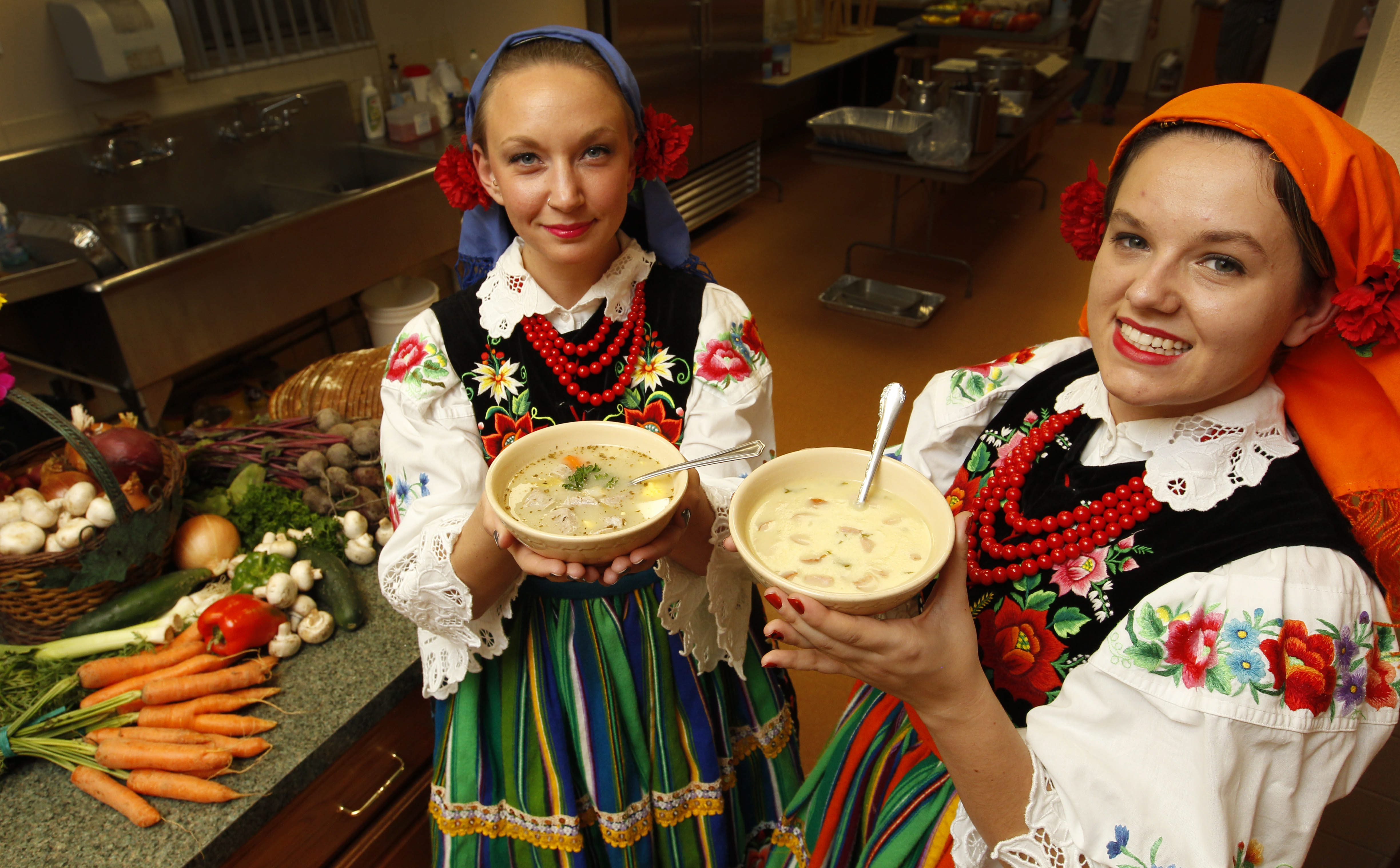 Corinne Lasek, left, and Diana Oramus, of the Polish Heritage Dancers of WNY present two of the soups at last year's  Zupapalooza. (Sharon Cantillon/Buffalo News)