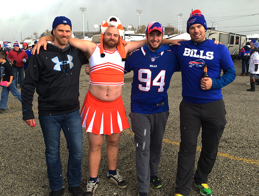 """A Bills fan from Toronto was forced by the guys in his wedding party to dress up as a Bengals cheerleader. Cold?  Nah. """"I'm Canadian,"""" he said.  (Photos by Nick Veronica/Special to the News)"""
