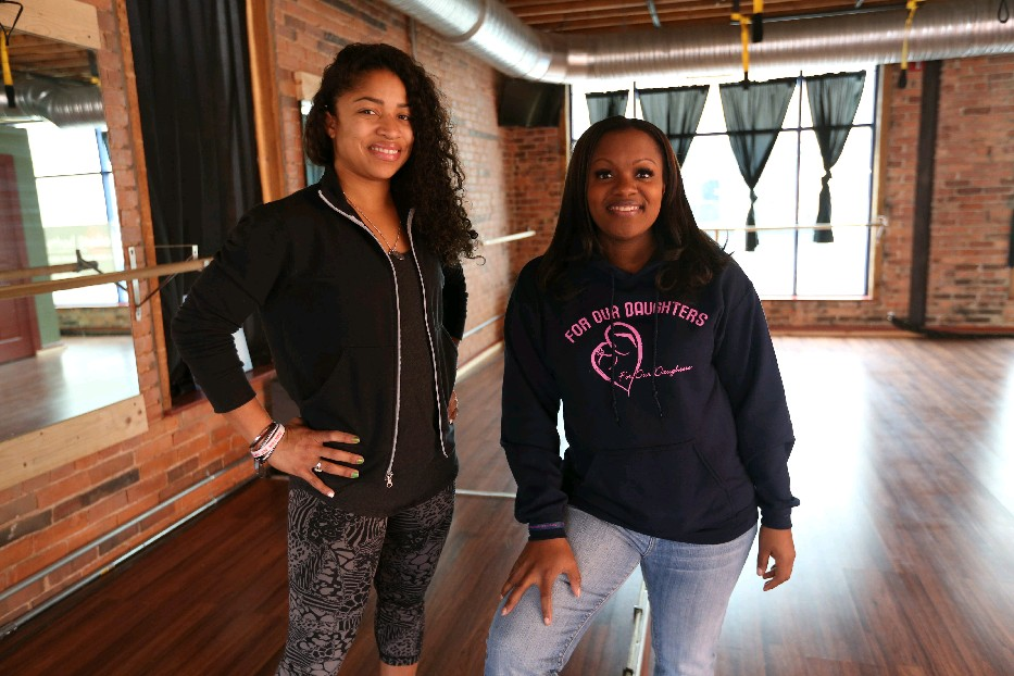 Ashley Stewart, left, owner of Fit Method Studio, has teamed up with Mercedes Holloway-Wilson, executive director of For Our Daughters to develop an educational and fitness program they've taken to several school districts. A fundraiser to benefit For Our Daughters takes place on Friday. (Sharon Cantillon/Buffalo News file photo)