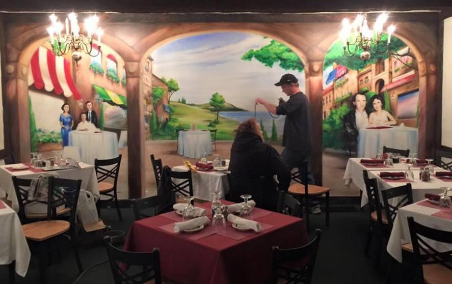 Murals in the revamped restaurant celebrate the neighborhood's heritage (Photo: Lombardi's Trattoria)
