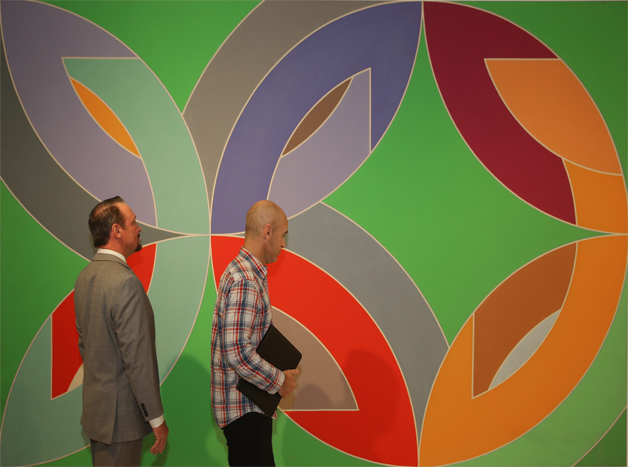 Brothers Paul and Stephen Scheeler returned to the Albright-Knox Art Gallery Friday to recreate a 1970 Buffalo News photograph of them in front of Frank Stella's 1969 painting 'Lac Laronge III.'