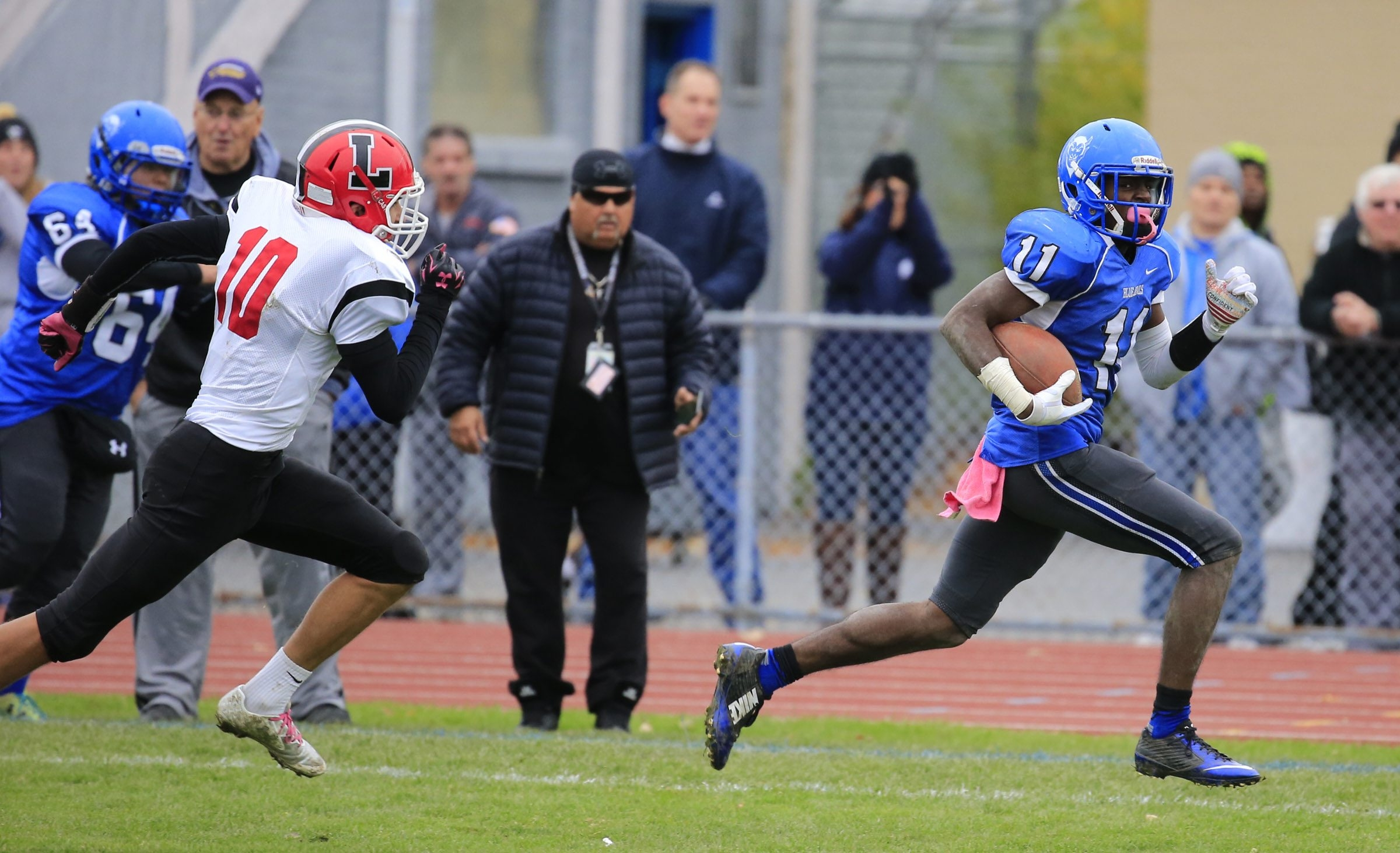 Kenmore West's Terrell Ford runs for one of his four touchdowns against Lancaster on Saturday at Crosby Field.