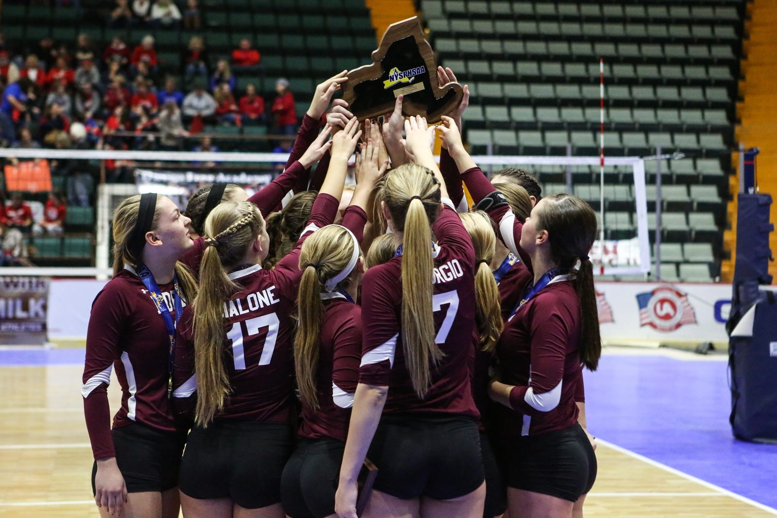 The Eden girls volleyball team lift the Class C championship class after defeated Millbrook to win the NYSPHSAA title in Glens Falls.
