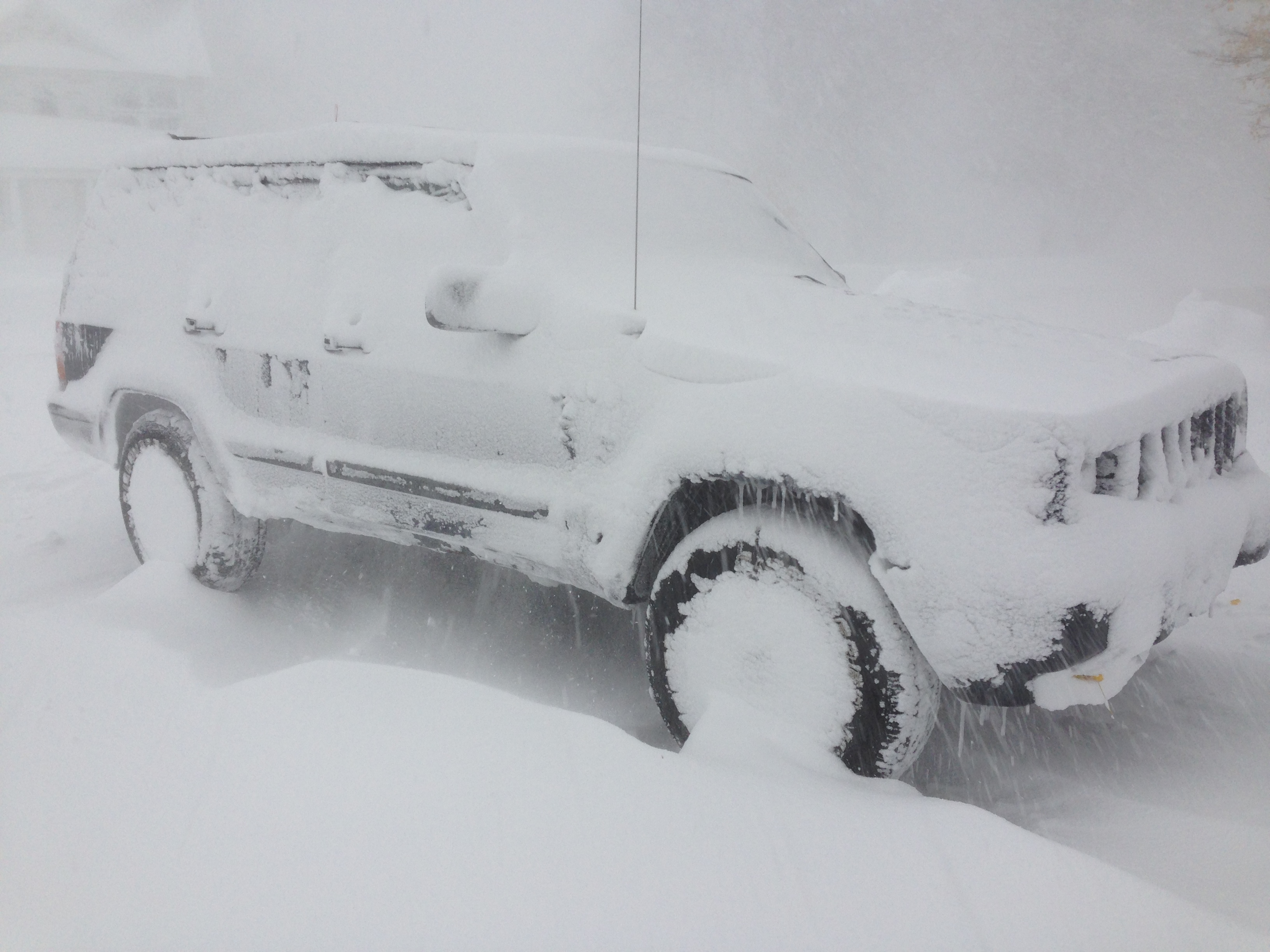 My 2000 Jeep Cherokee boasted more than 232,000 miles and drove through a pair of blizzards before meeting the 'Wall of Snow' on Nov. 18, 2014. We both survived. (T.J. Pignataro / Buffalo News)