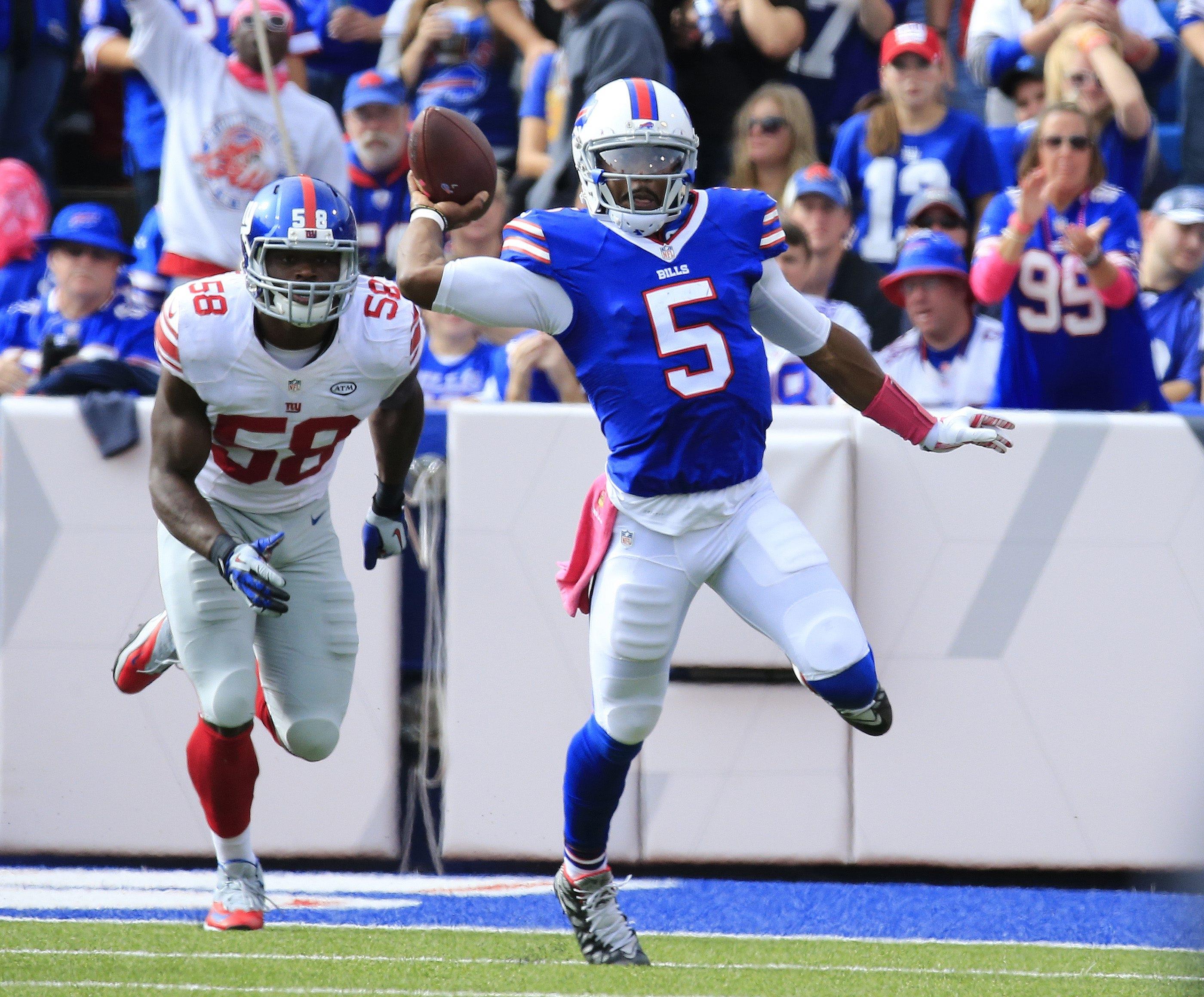 Buffalo Bills  Tyrod Taylor throws against the New York Giants  during third quarter action at Ralph Wilson Stadium on Sunday, Oct. 4, 2015.  (Harry Scull Jr./Buffalo News)