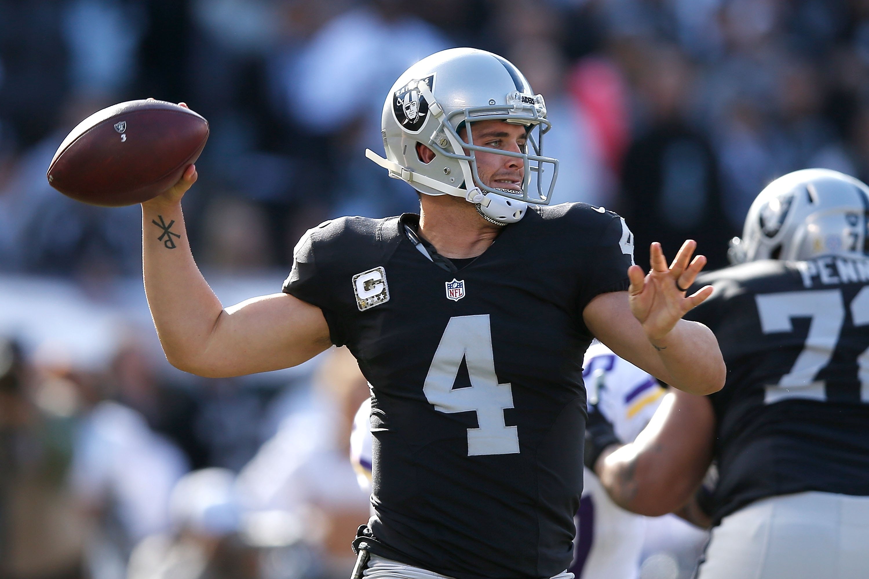 Quarterback Derek Carr of the Oakland Raiders looks downfield  against the Minnesota Vikings in the first quarter at O.co Coliseum on Nov. 15, 2015.