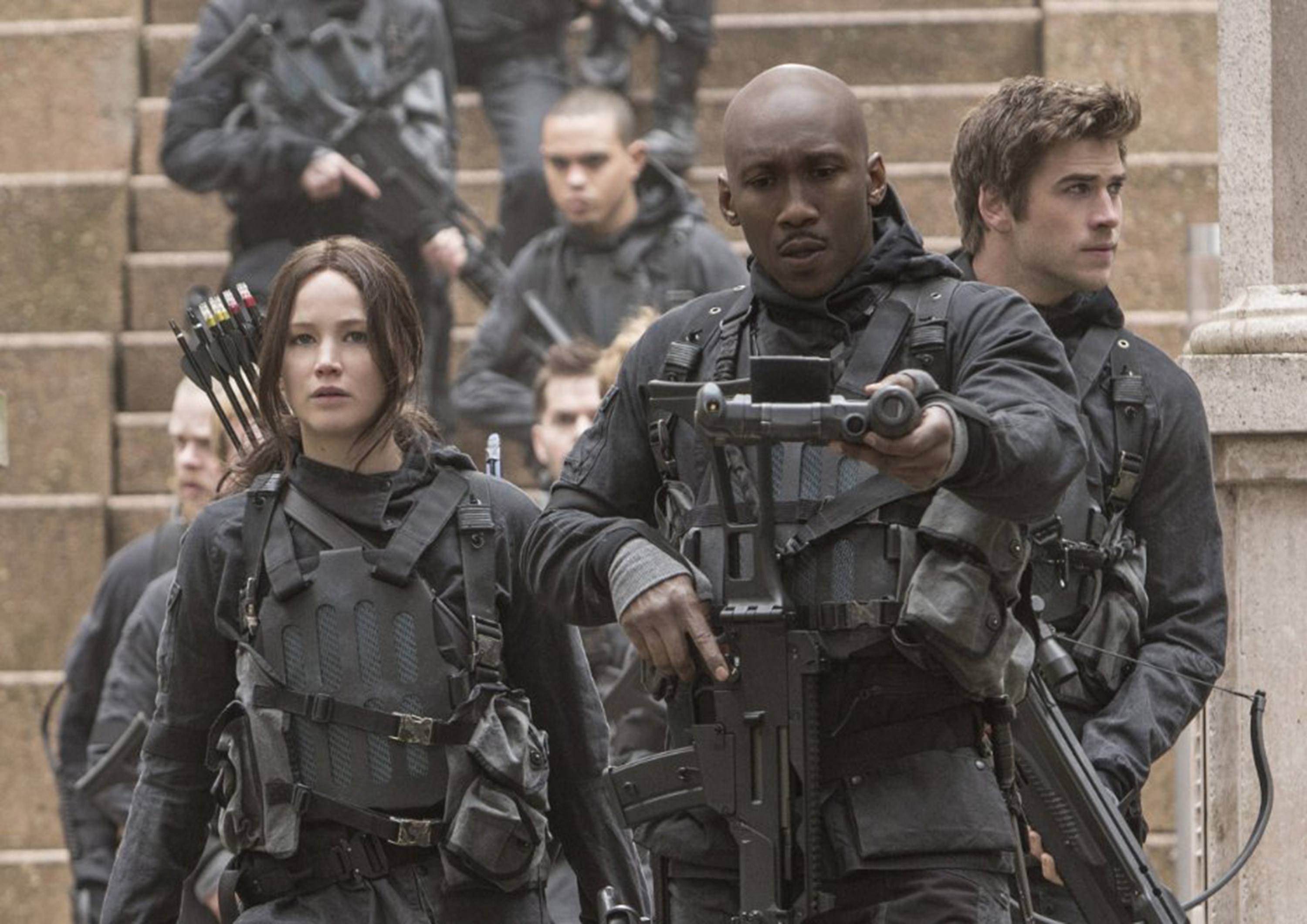 "Jennifer Lawrence, Mahershala Ali and Liam Hemsworth in ""The Hunger Games: Mockingjay -- Part 2."" (Photo courtesy Lionsgate/TNS)"
