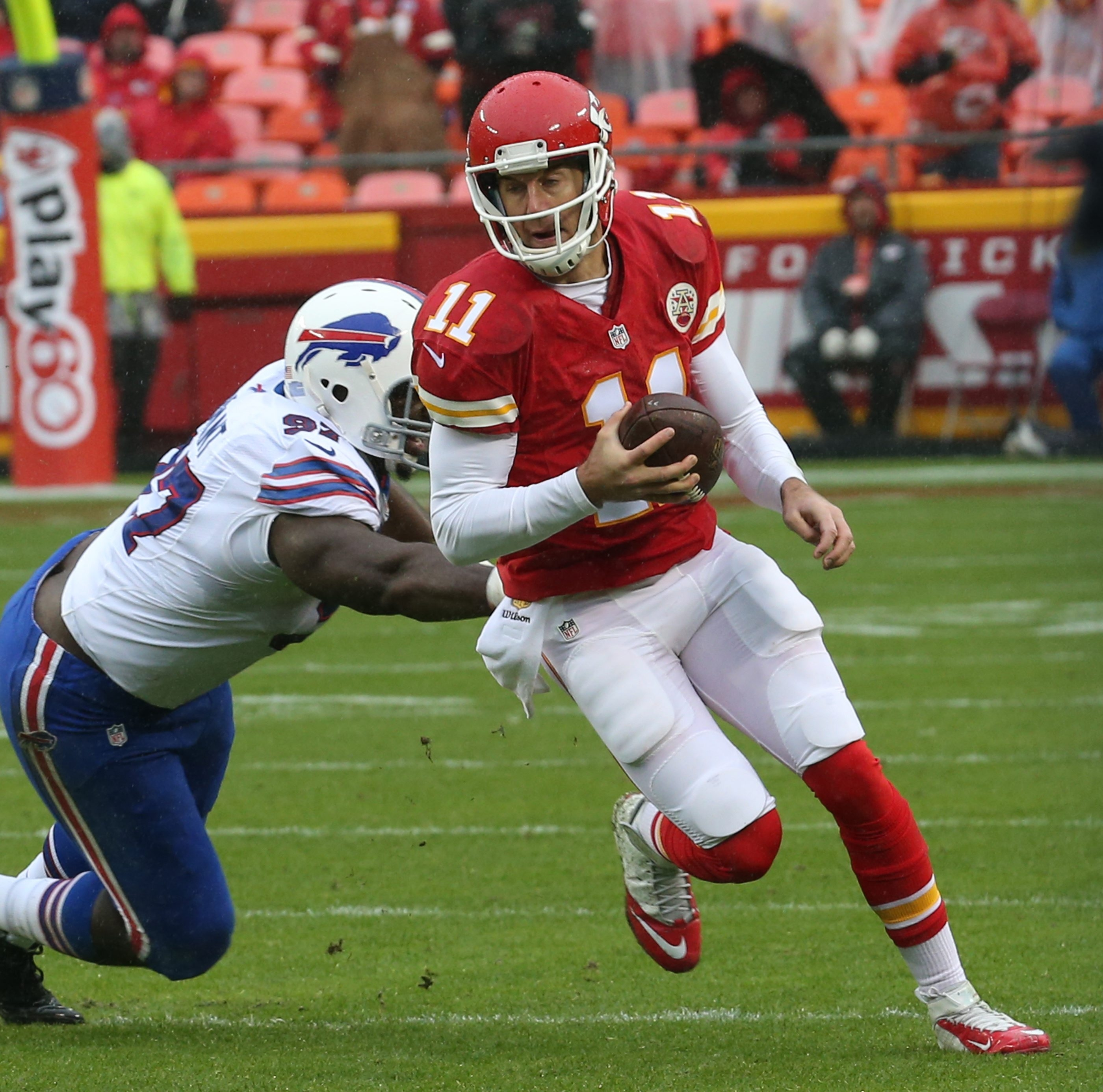 Chiefs quarterback Alex Smith eludes Bills defensive tackle Corbin Bryant for a first down in the second quarter.
