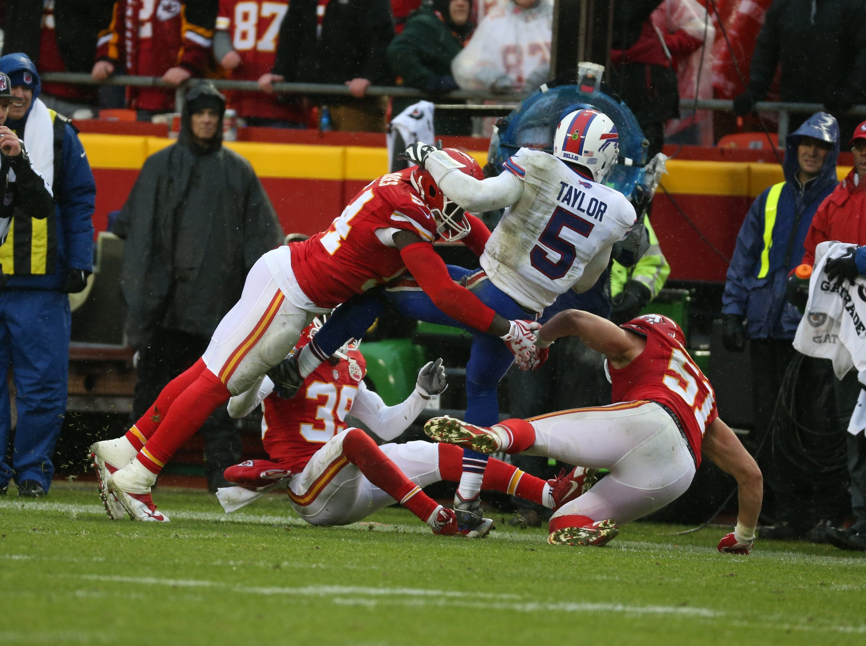 Buffalo Bills quarterback Tyrod Taylor, encircled by a trio of Kansas City Chiefs, dives for the first down in the fourth quarter but came up short Sunday.