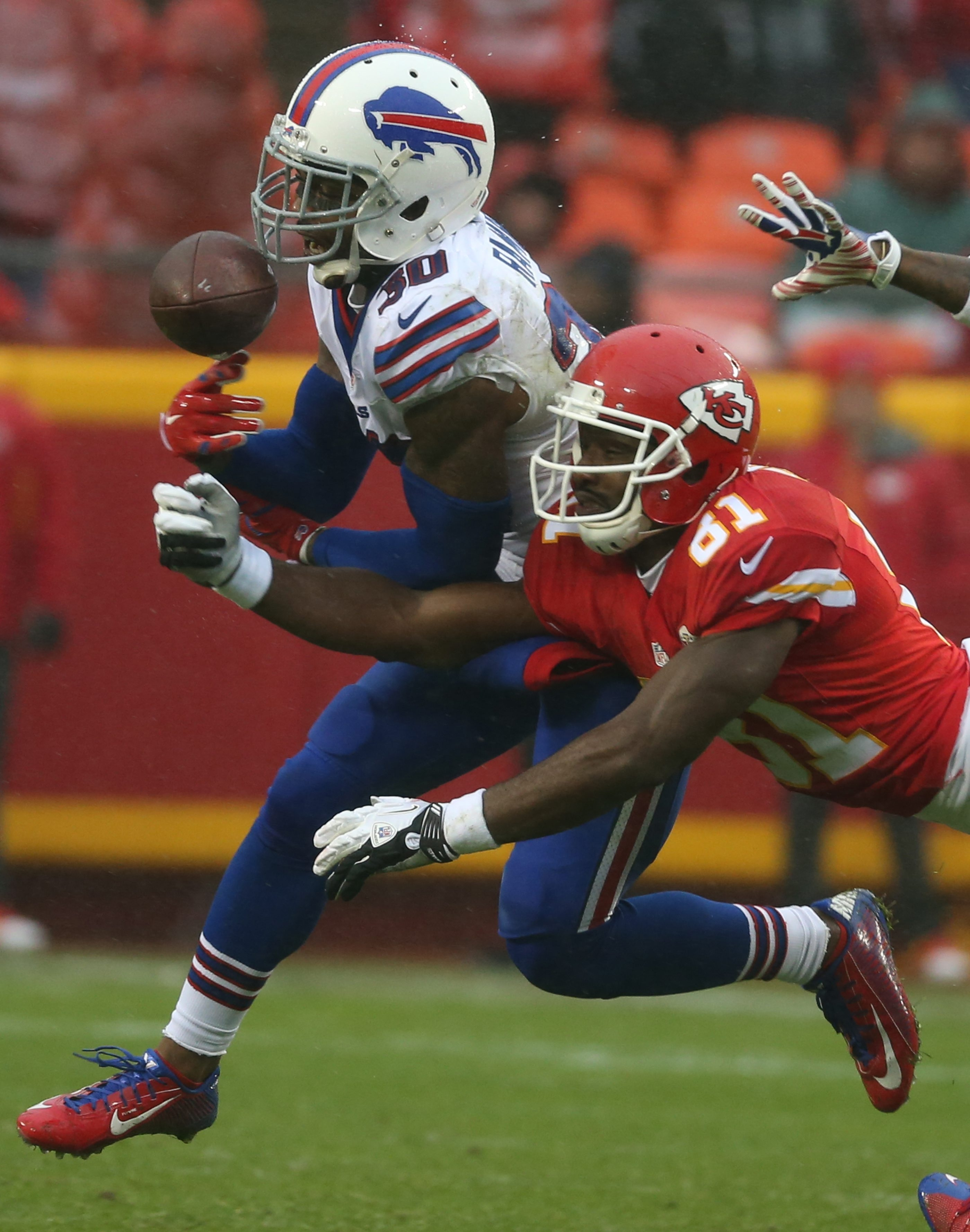 Bills strong safety Bacarri Rambo drops a interception and possible pick-six in front of Kansas City Chiefs wide receiver Jason Avant during the second quarter at Arrowhead Stadium.