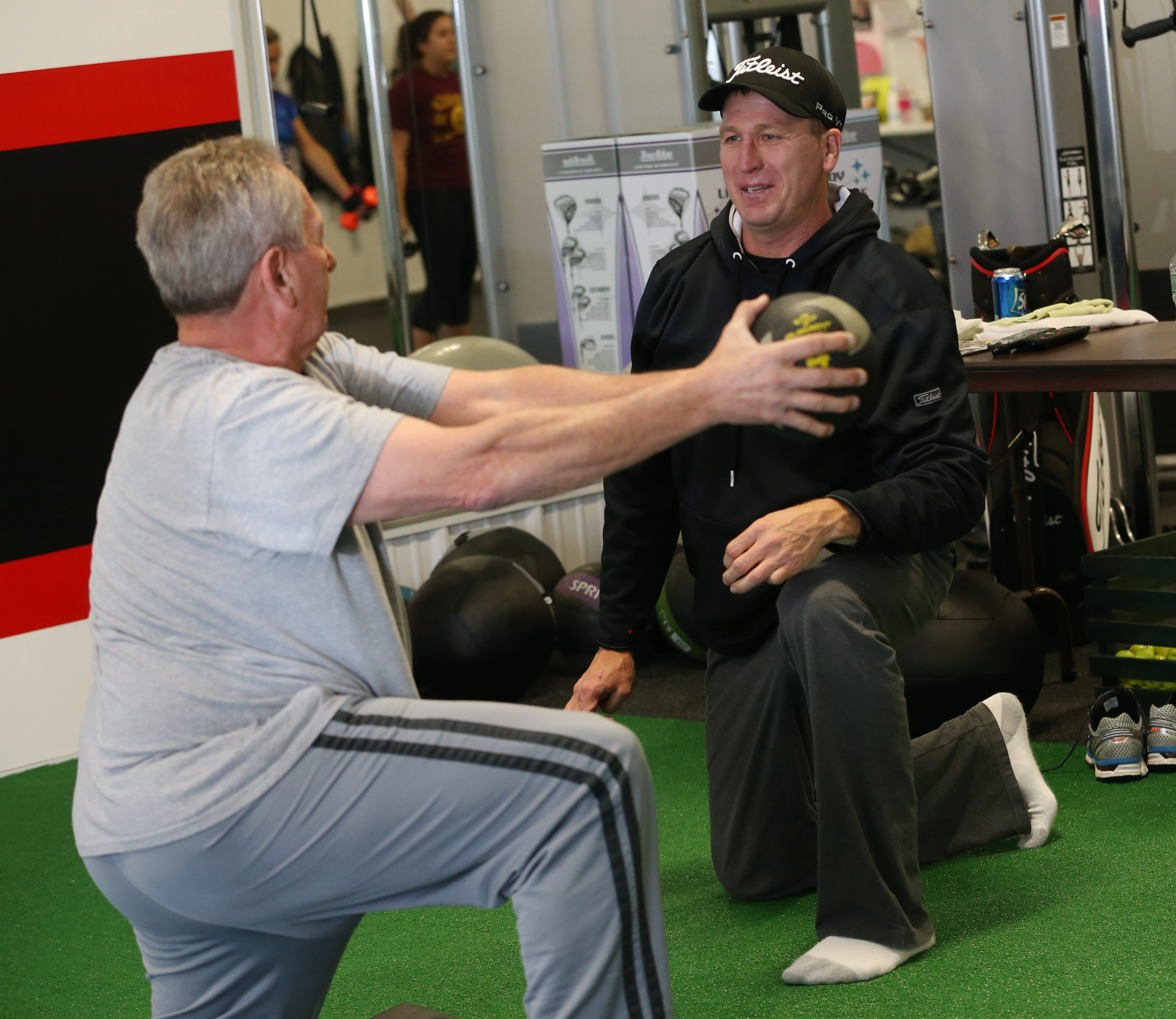 """""""We're interested in the entire person. """"  – Mark Schraven, who with his wife, Michelle, opened Advantage Fitness in Lancaster. Above, Mark Schraven works with Dan Amatura."""