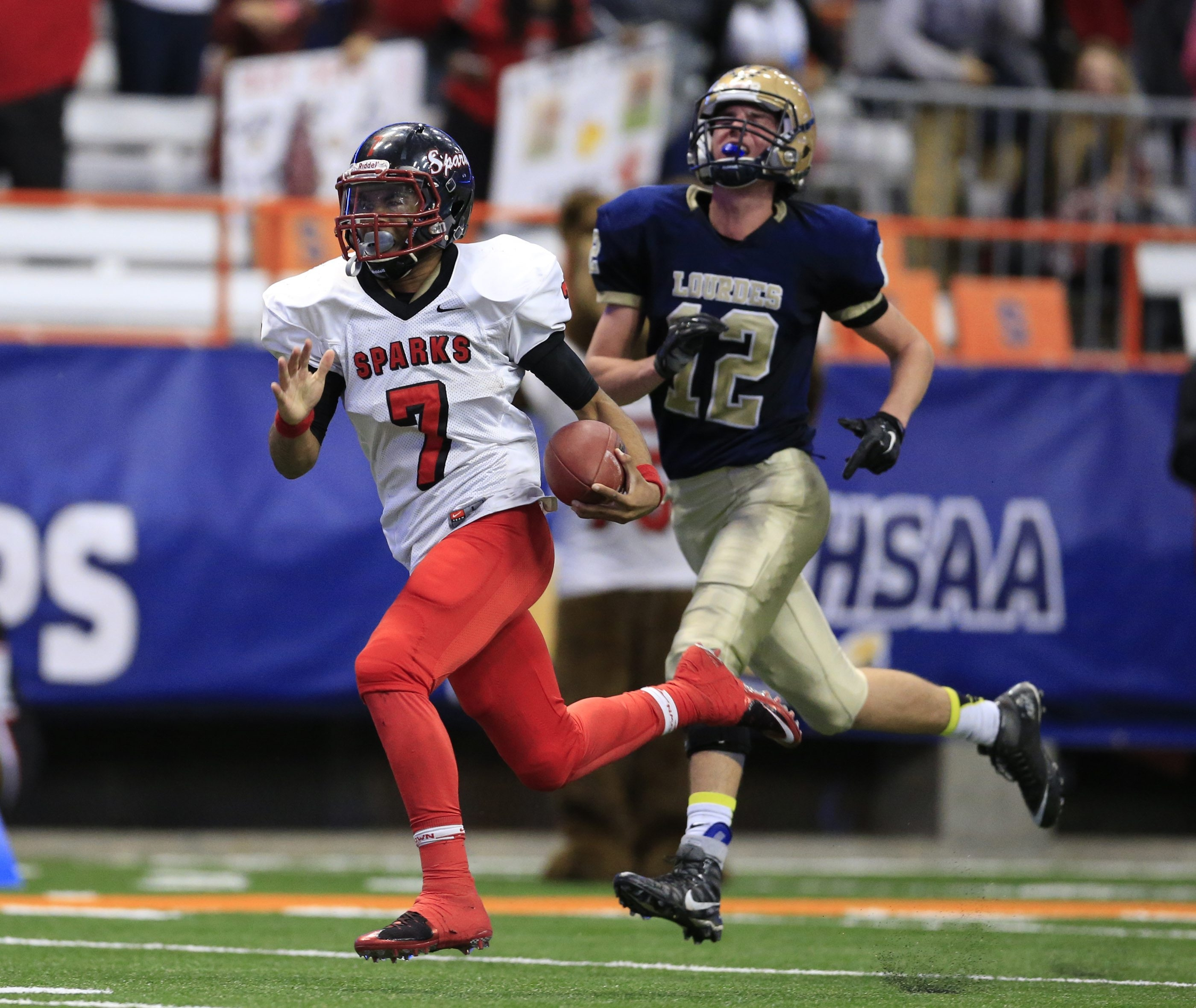 South Park quarterback Tyree Brown runs for a touchdown against Our Lady of Lourdes during the first half of the NYSPHSAA Class A state championship in Syracuse. Brown finished with 217 yards on 11 carries and four rushing touchdowns.