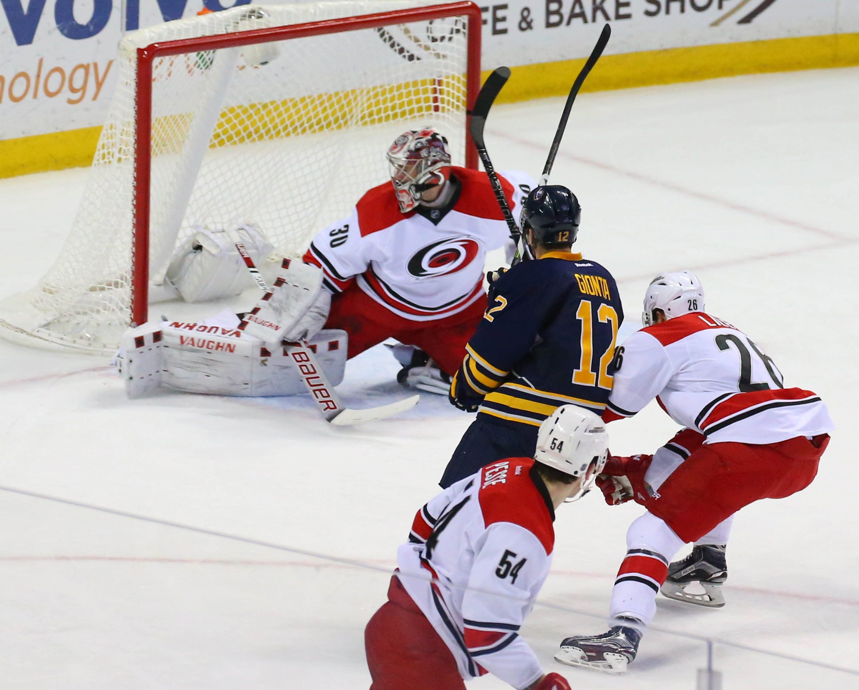 Sabres captain Brian Gionta scores on Hurricanes goalie Cam Ward during Friday's game at the First Niagara Center.