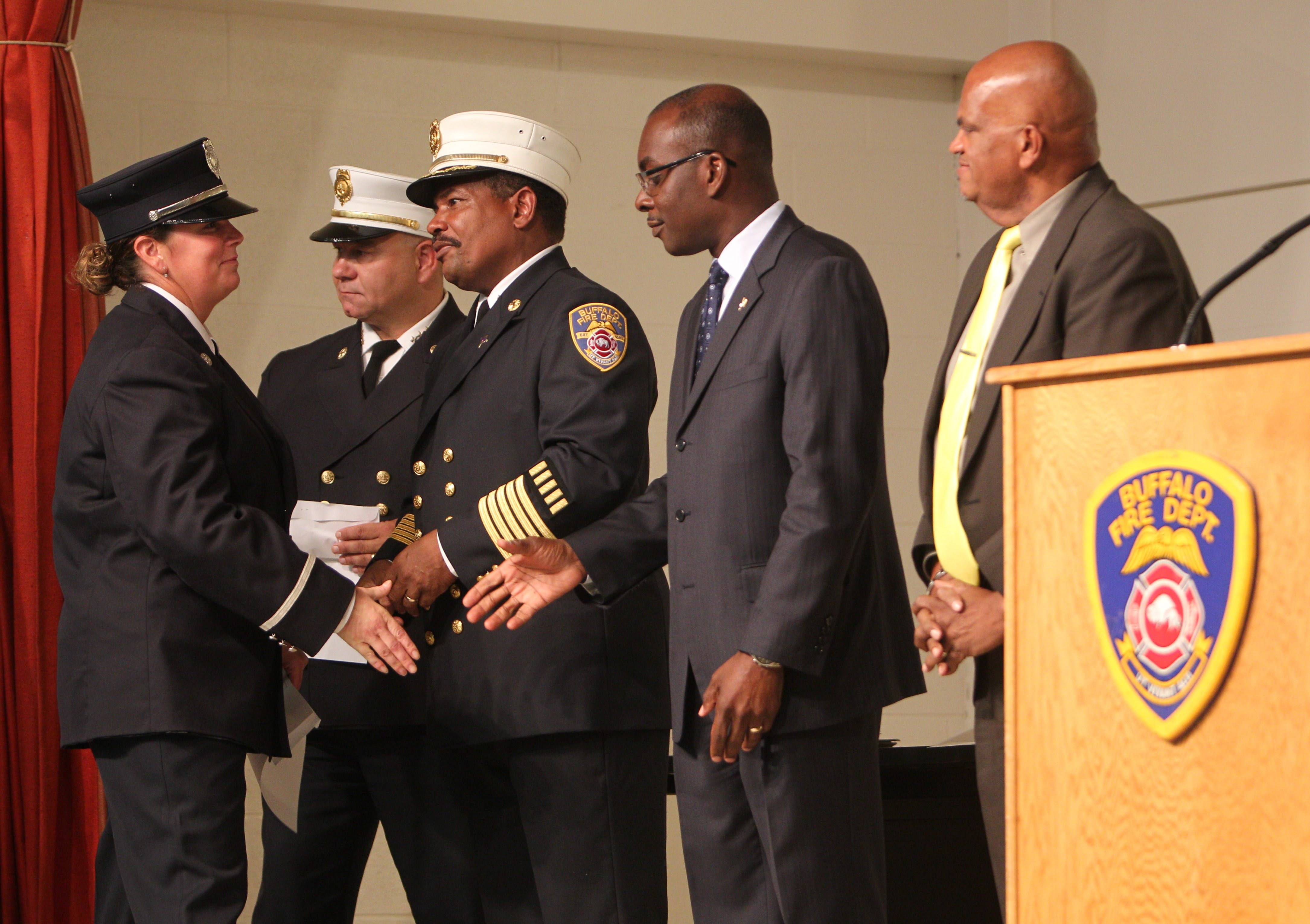 During the Buffalo Fire Department's promotions ceremony on Sept. 16, 2013, 43 firefighters were promoted to positions of division chief, battalion chief, captain and lieutenant. From left, Wendy Majtyka-Hartman is promoted to captain, and is being congratulated by then-Assistant Fire Commissioner Joseph Tomizzi; Fire Commissioner Garnell Whitfield Jr.; Mayor Byron W. Brown and Chaplain Angel Gauthier.