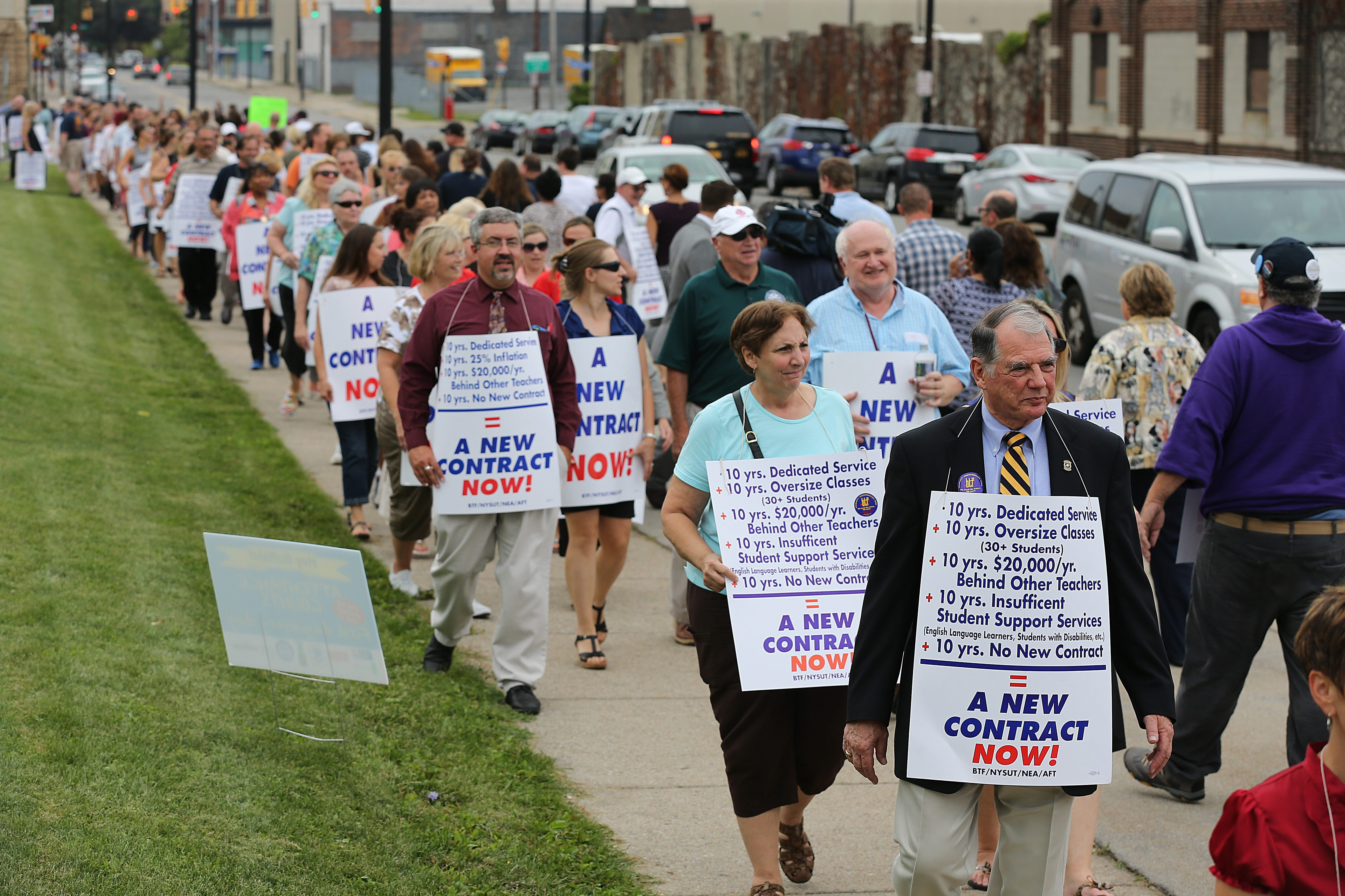 A Buffalo News file photo from September 2014 shows President Phil Rumore, right, with members of the Buffalo Teachers Federation in picketing outside a school board meeting at the Buffalo Academy for the Visual & Performing Arts. (Buffalo News file photo)