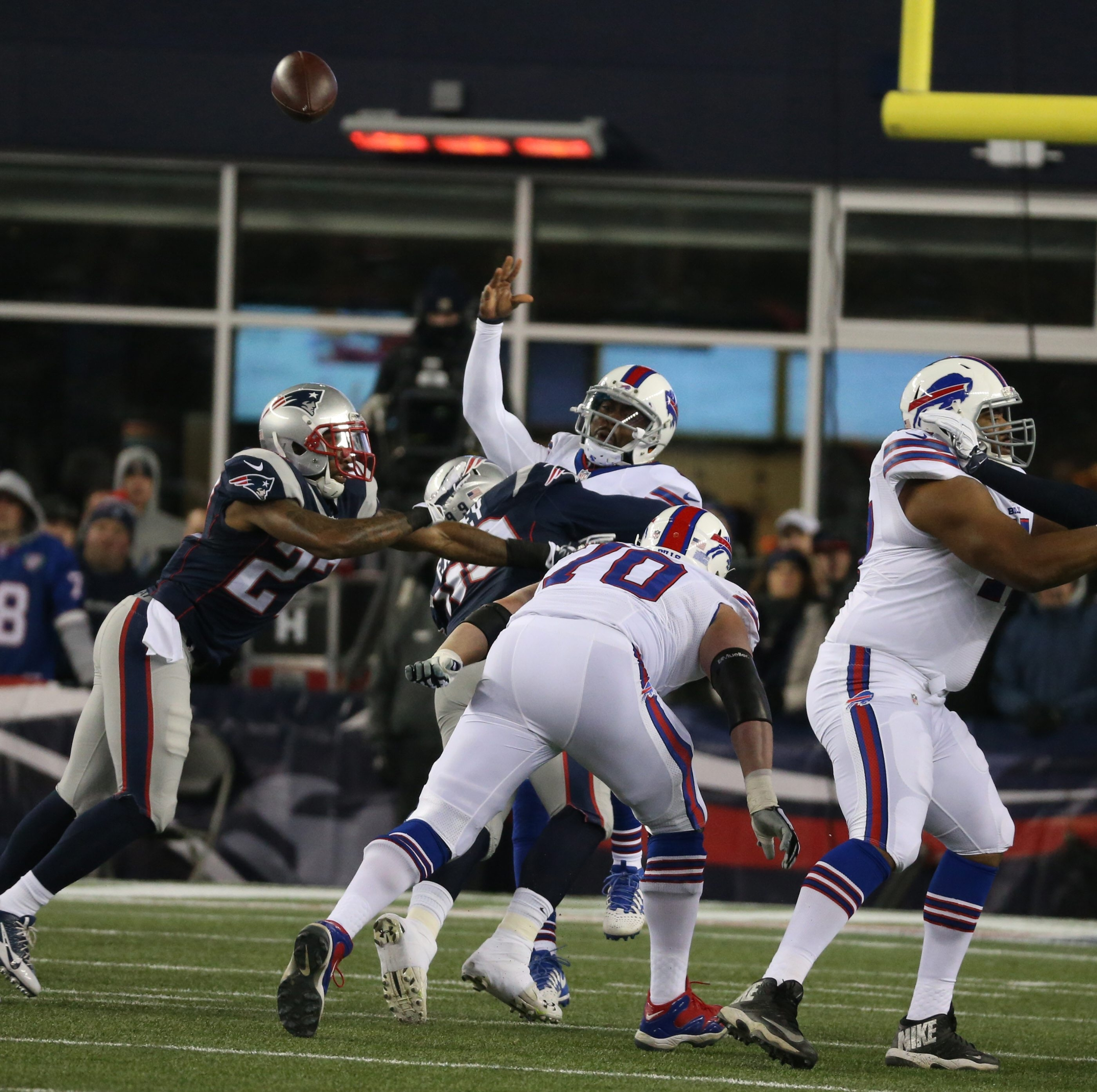 Bills quarterback Tyrod Taylor throws under pressure from the Patriots in the first quarter Monday night in Foxborough, Mass.
