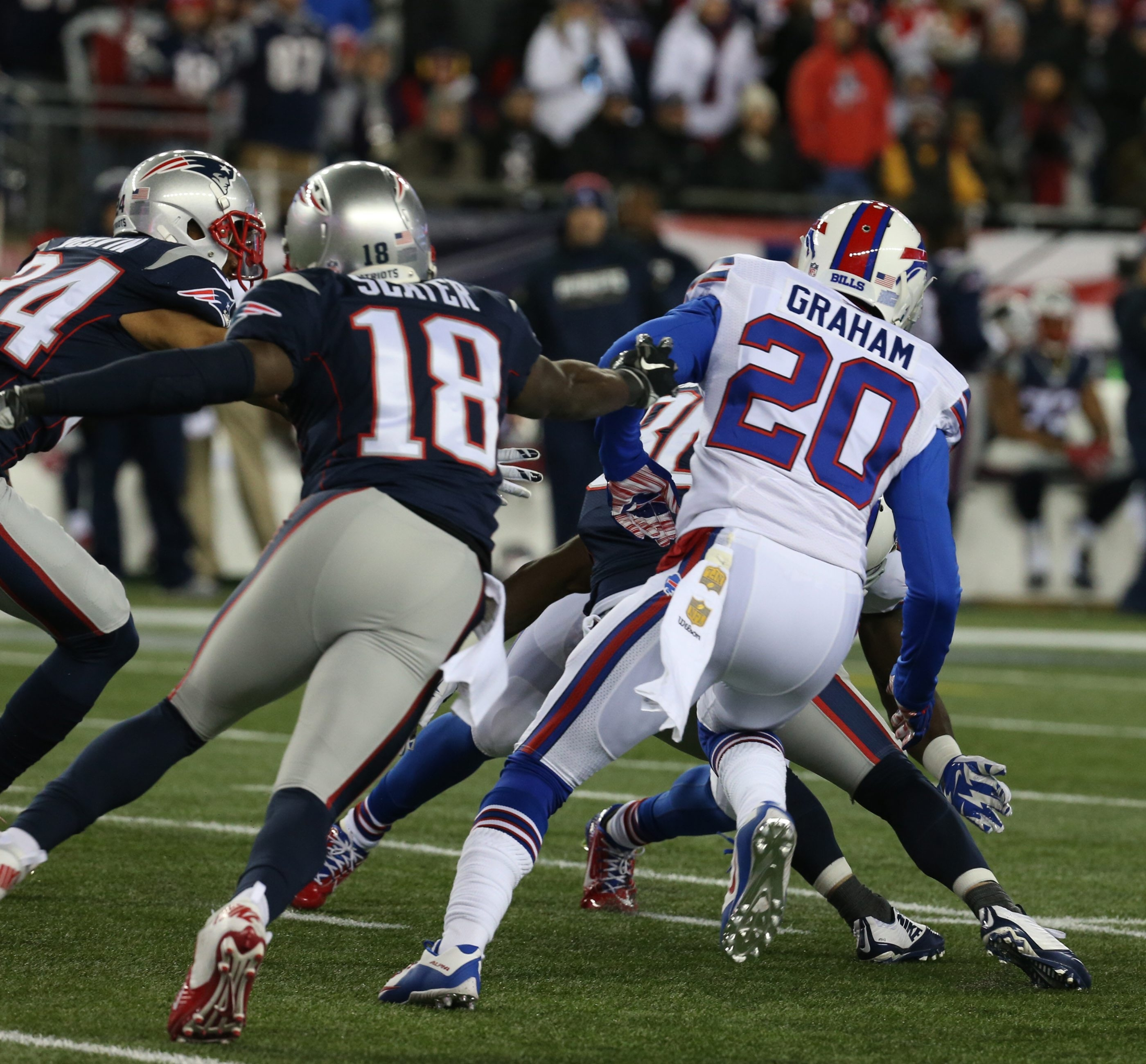Corey Graham and other Bills players make a tackle in the first quarter of Monday night's game with the Patriots at Gillette Stadium.