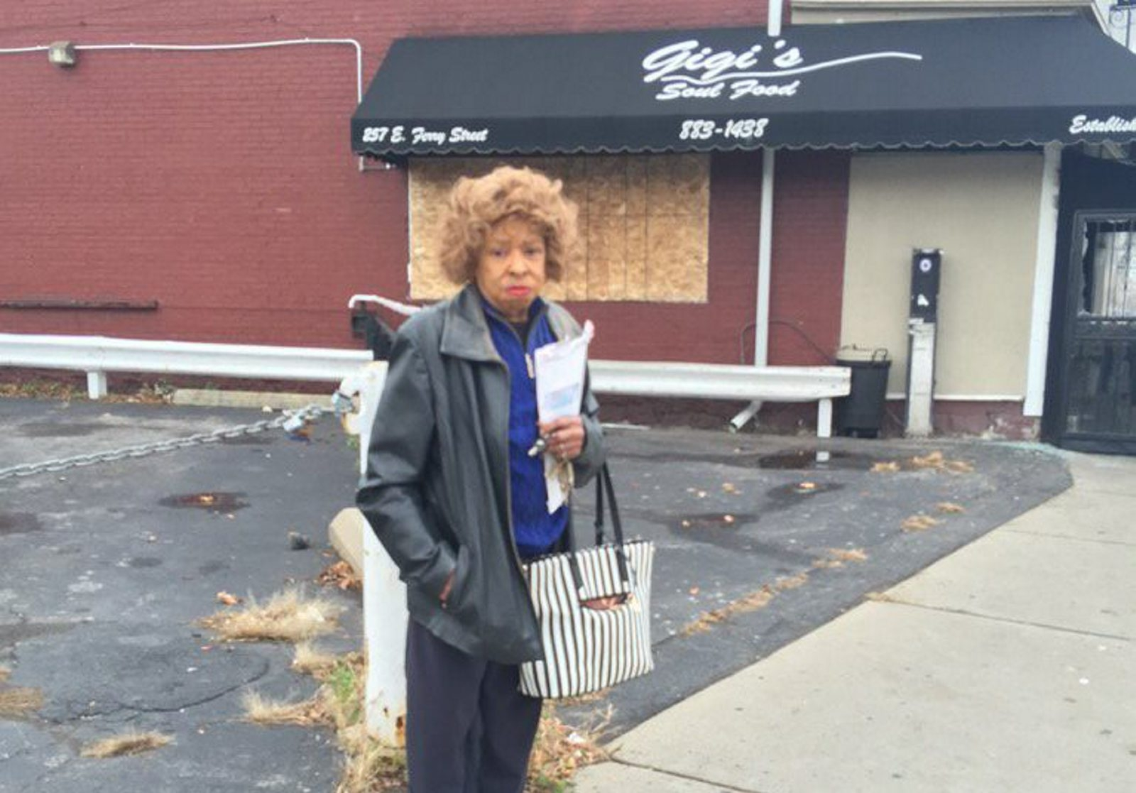 Owner Blondine Harvin is seen outside Gigi's restaurant Saturday morning after an early morning fire damaged the building. (Jane Kwiatkowski Radlich/Buffalo News)